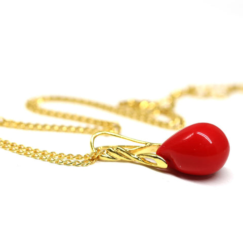 Bright red drop glass pendant on golden coated chain