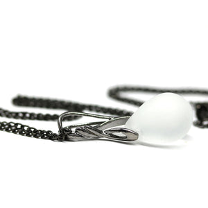 Frosted clear drop glass pendant on black rhodium chain
