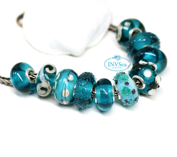 Scrolls on teal European style charm