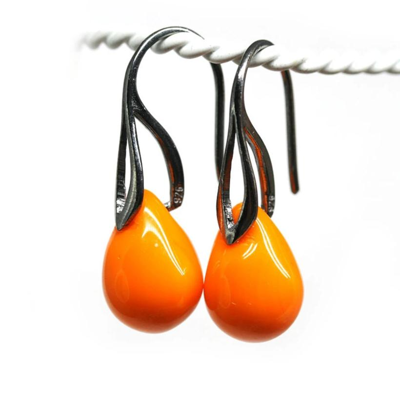 Opaque bright orange drop glass Halloween earrings