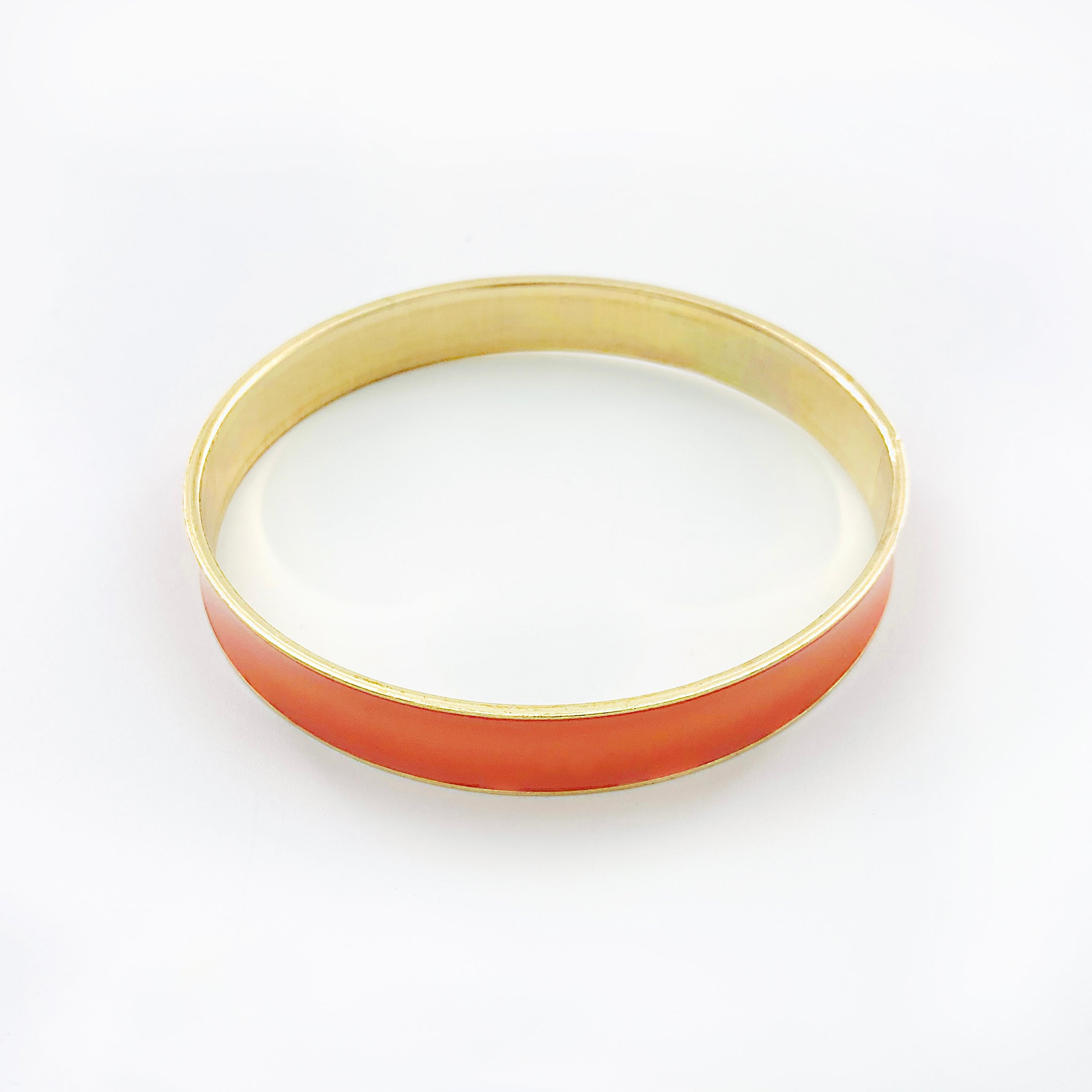 Coral pink and gold bangle with enamel finish