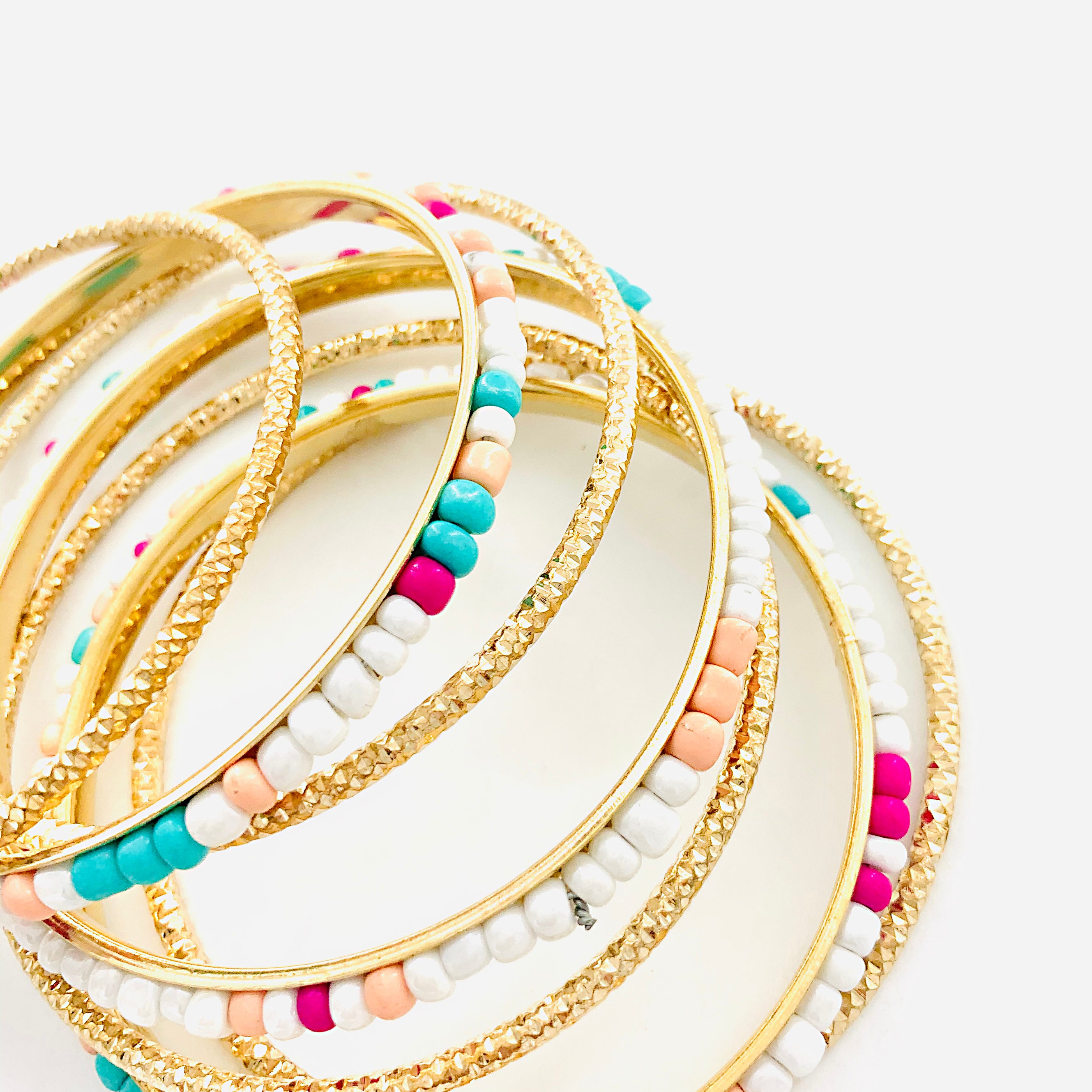 Gold Bangles of Pink, Turquoise, Coral and White Beads