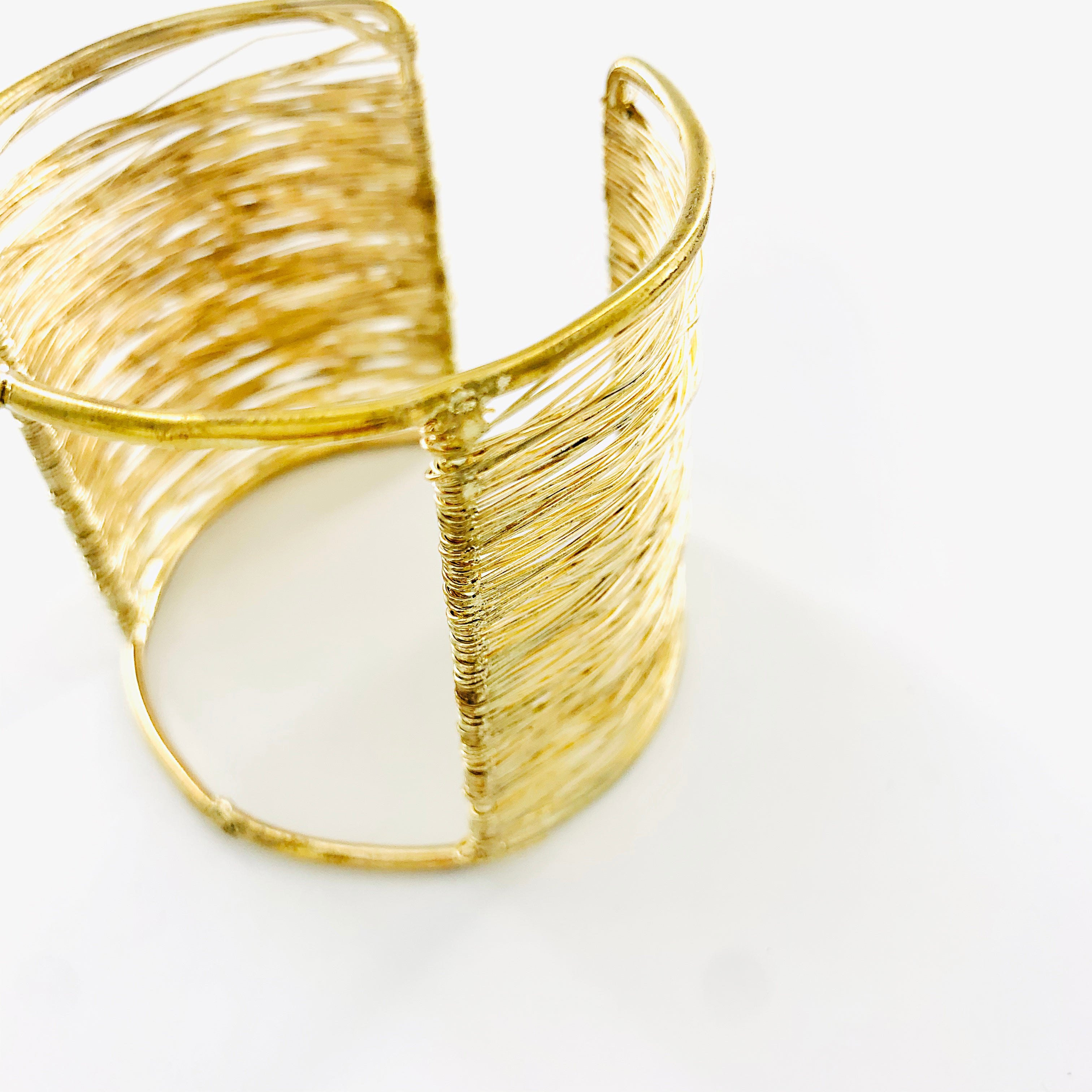 Gold cuff with twisted mesh design