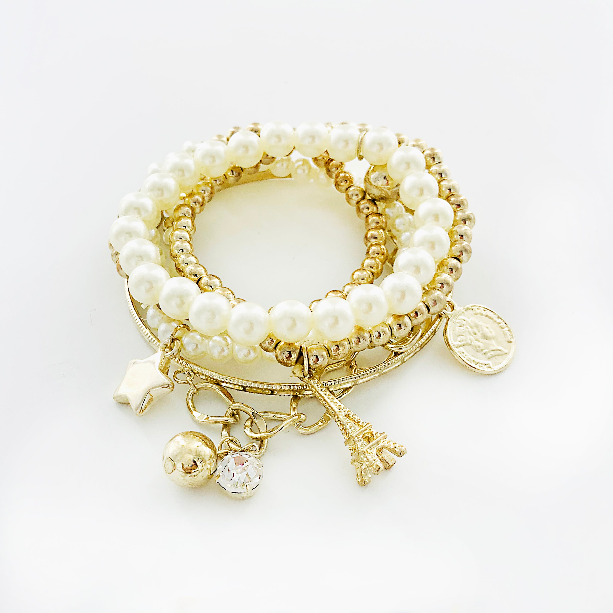 Pearl and gold bracelets with Paris and star Charms