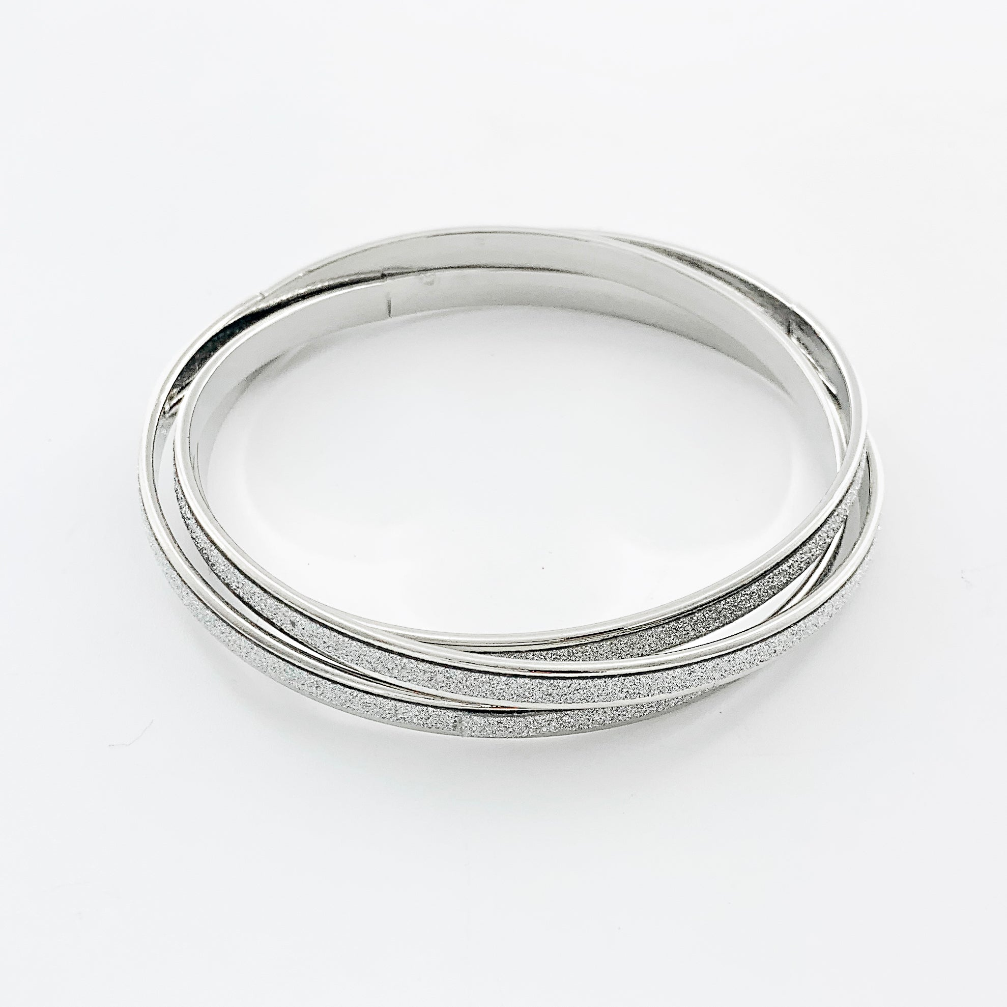 Thin silver bangles with glitter finish