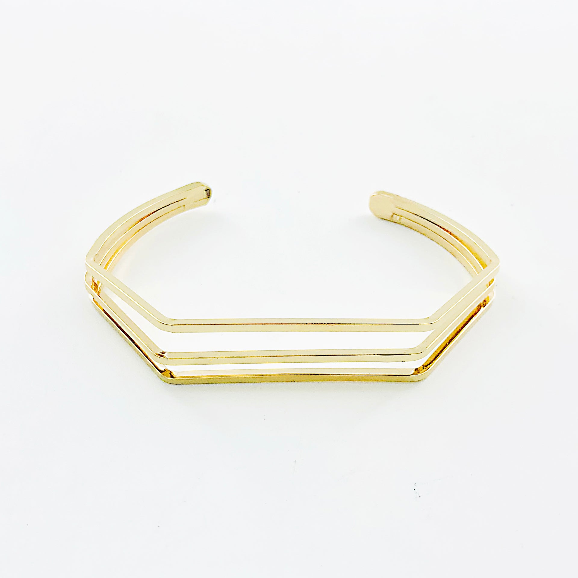 Thin gold bangles with geometric line design