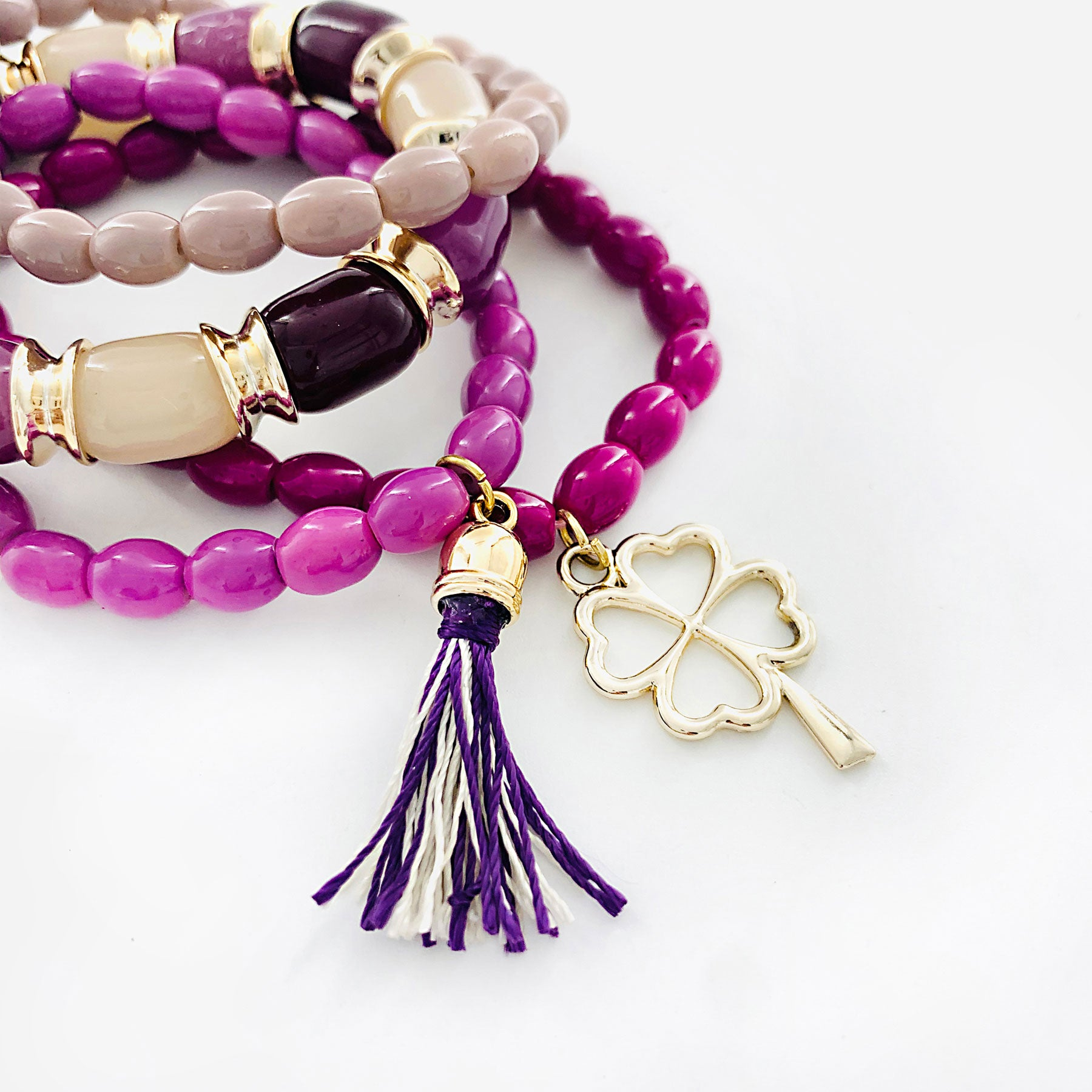 Violet and Mauve bracelet with gold clover and tassel charm