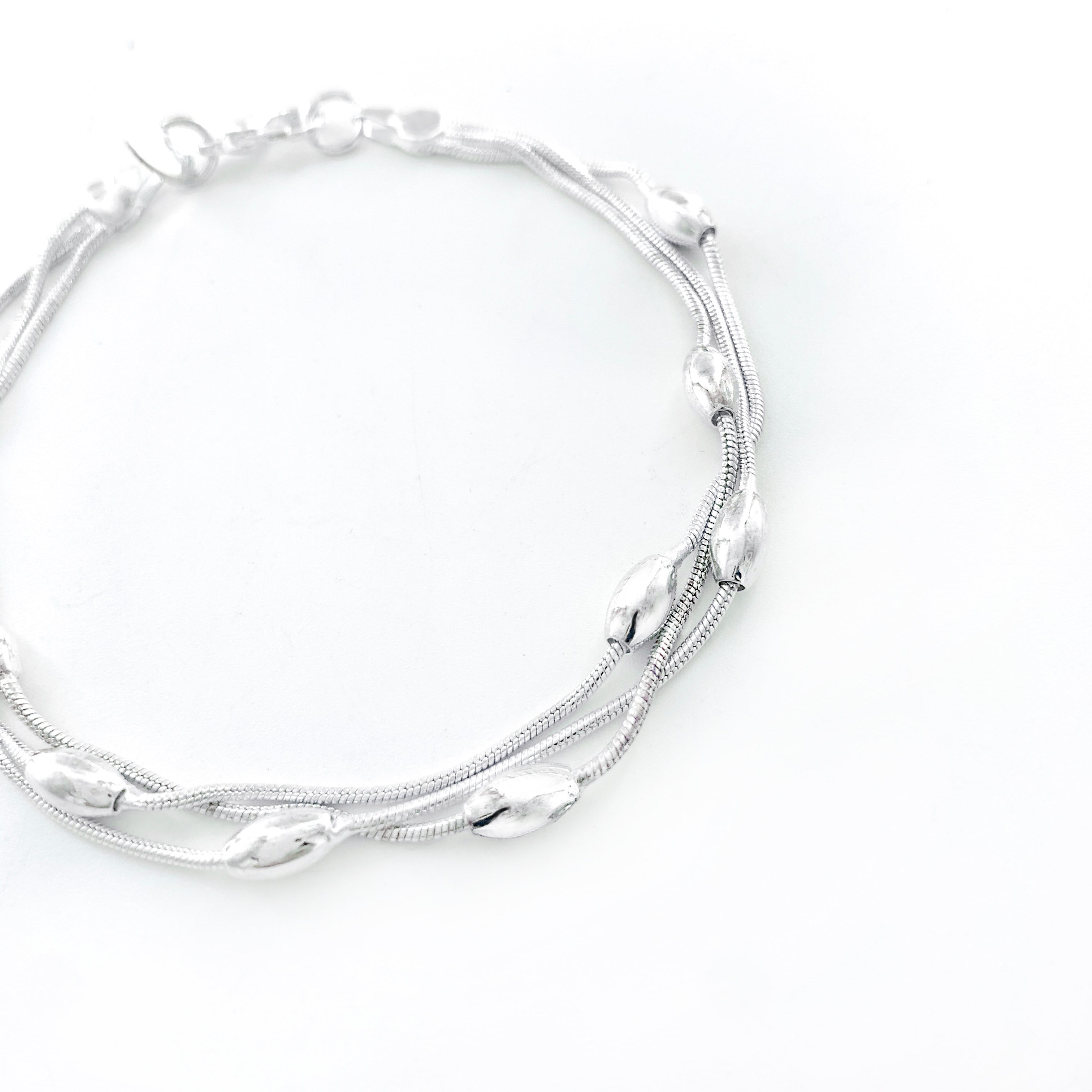 Silver bracelet with oval accents