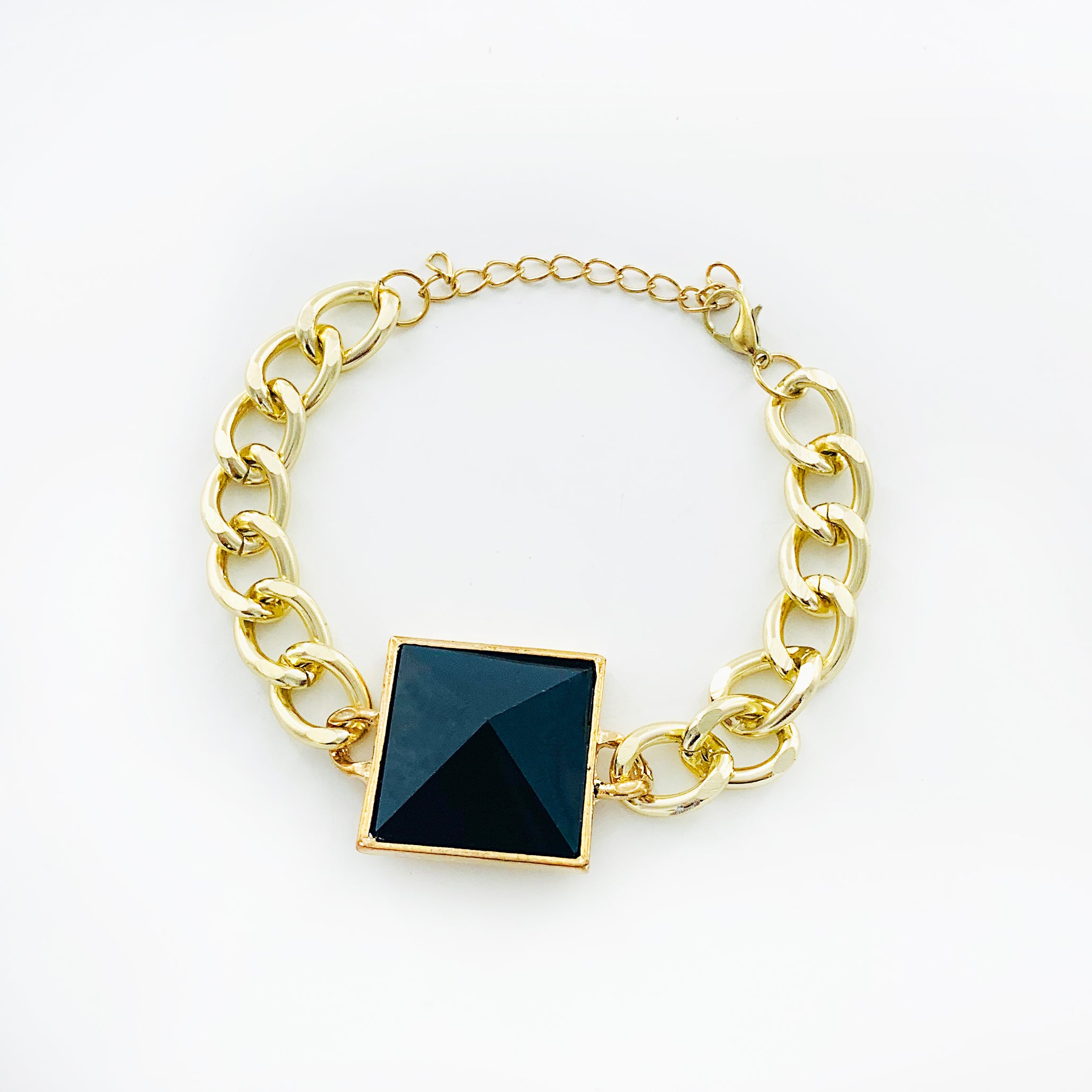 Gold chunky chain with large black faceted stone