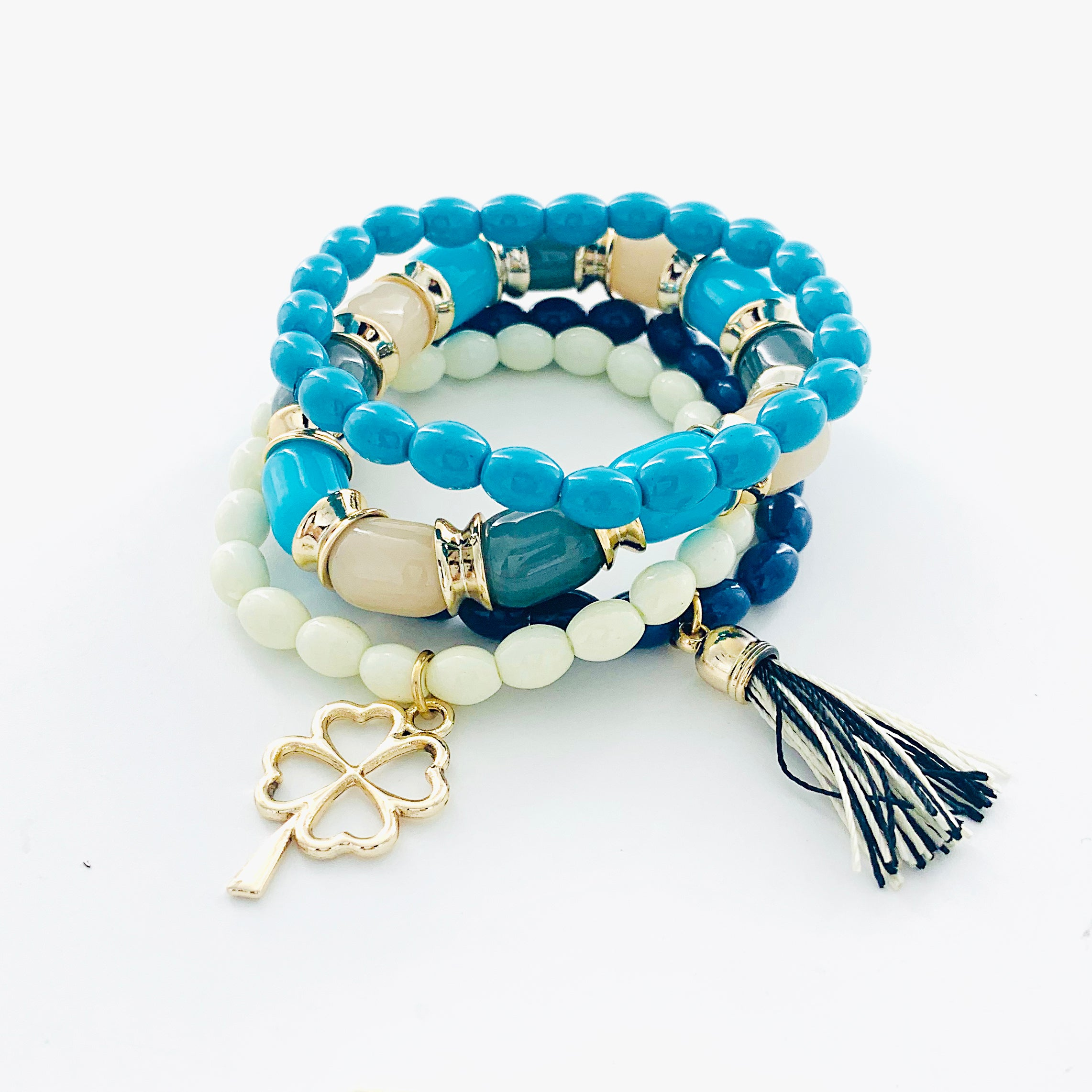Blue and White bracelet with gold clover and tassel charm