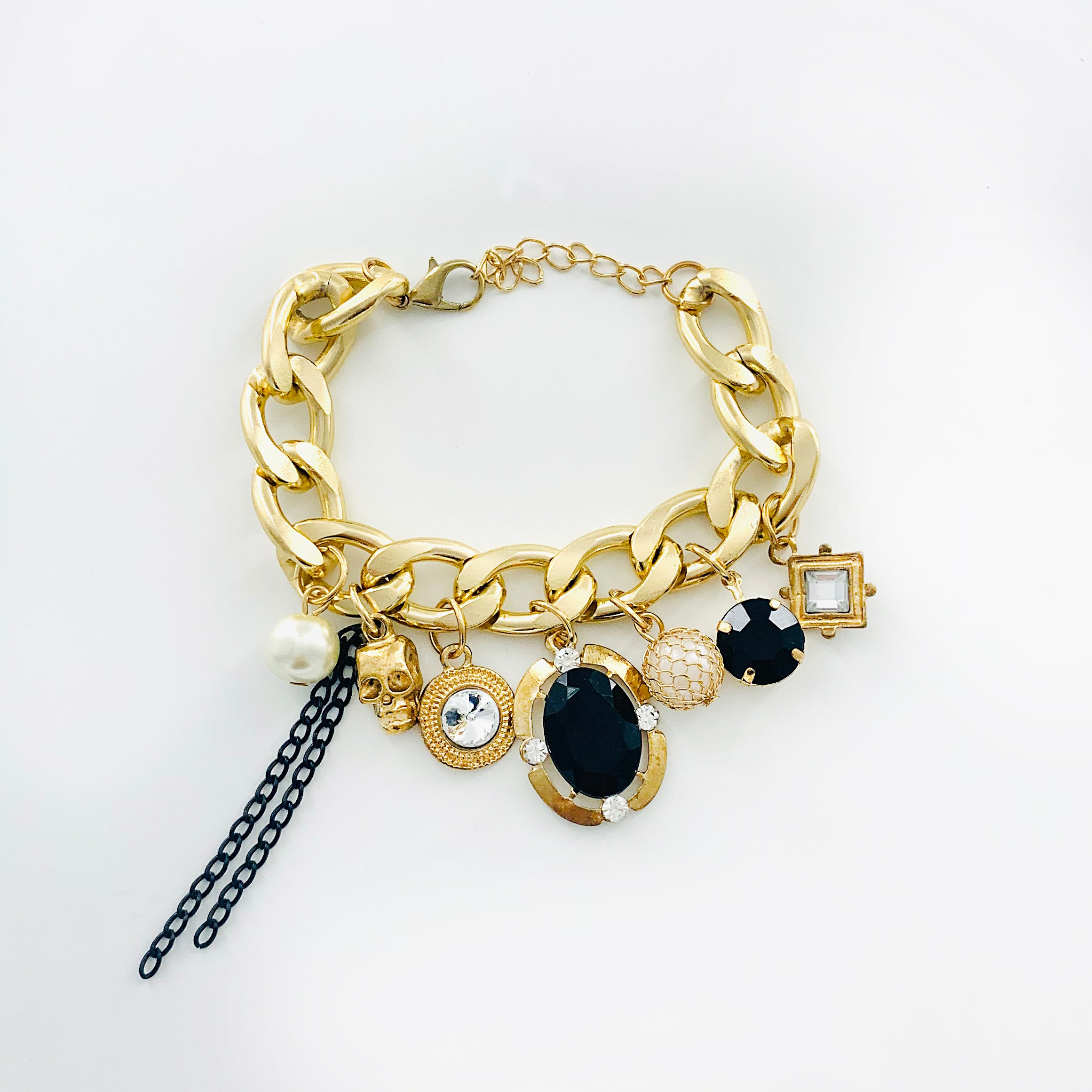 Gold chunky chain with skull and gem charms