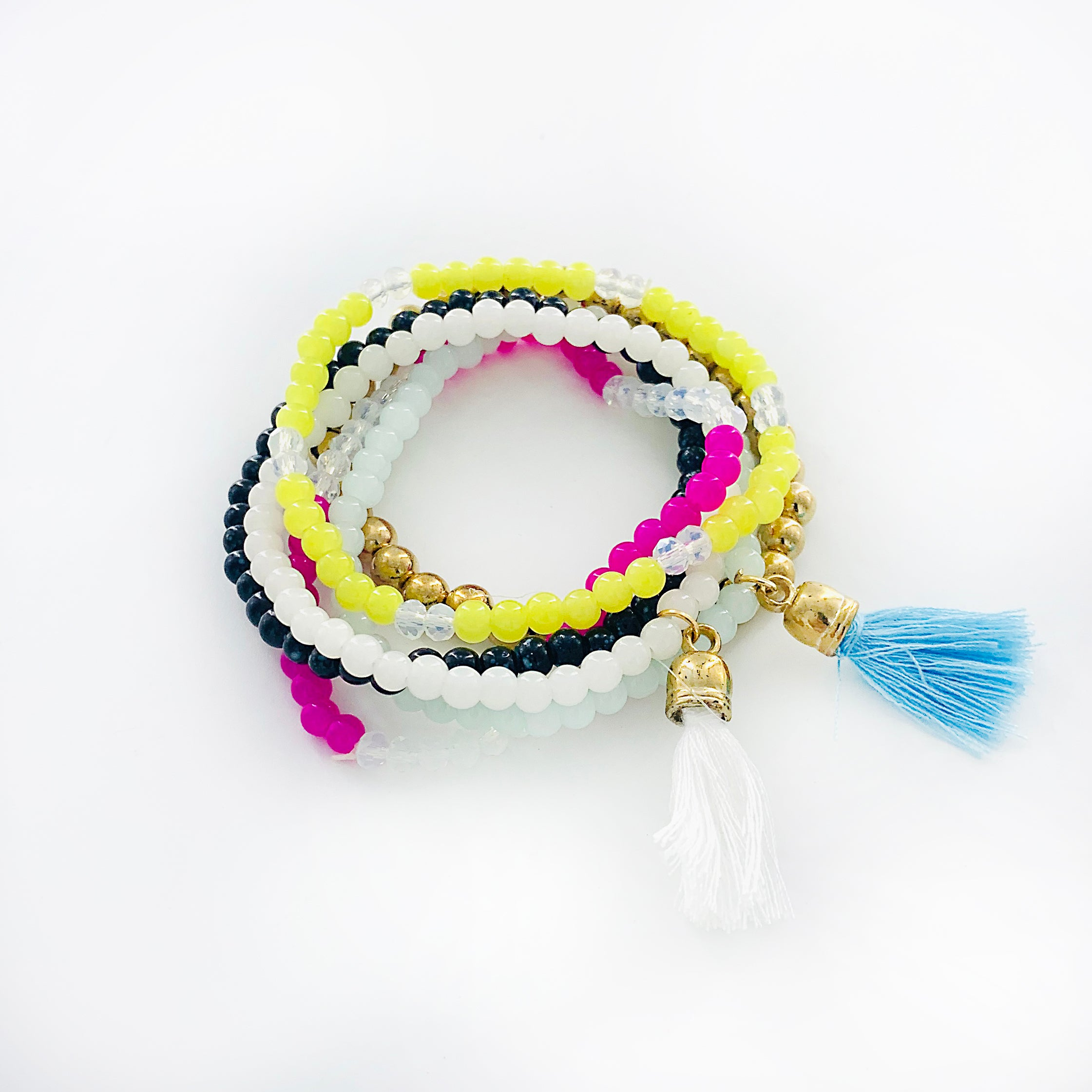Multi-coloured beaded bracelet with tassel charms