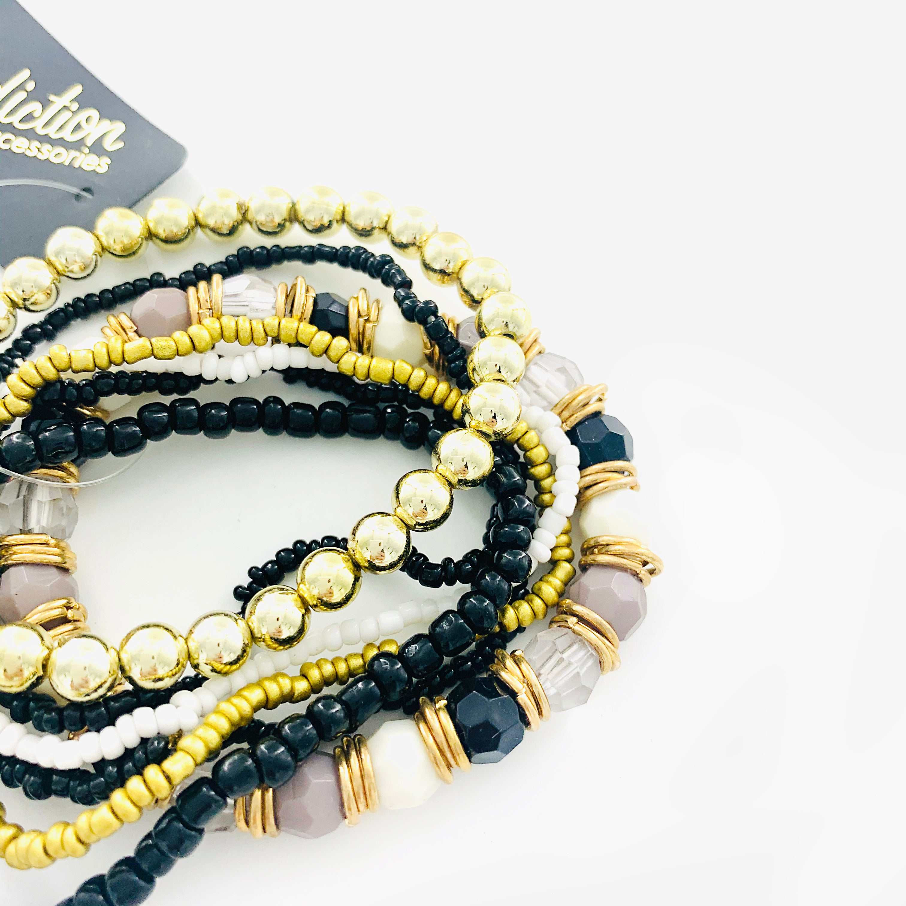 Black and gold beaded bracelet with faceted stones