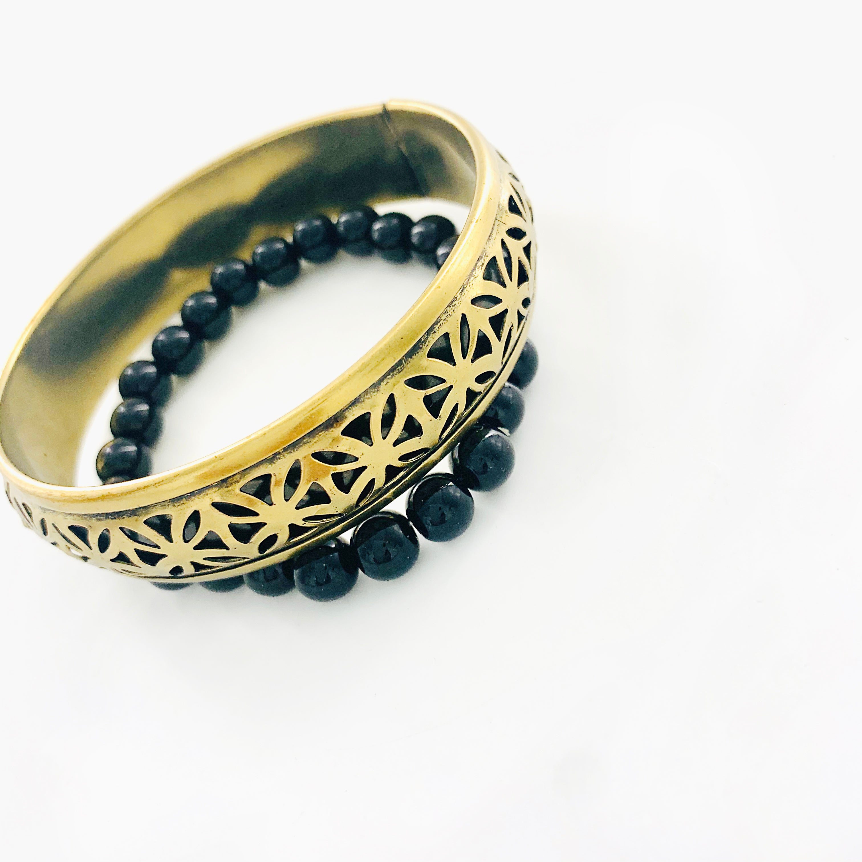 Black beaded bracelet with rustic gold bangle