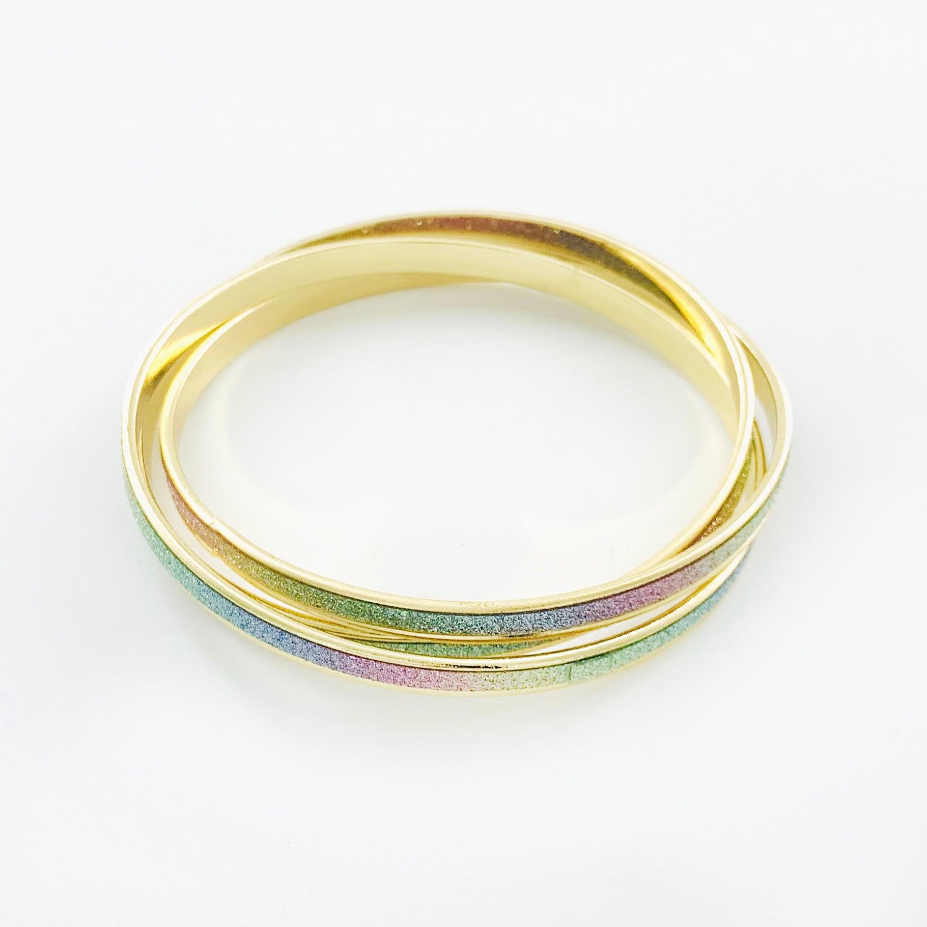 Thin gold bangles with rainbow glitter finish