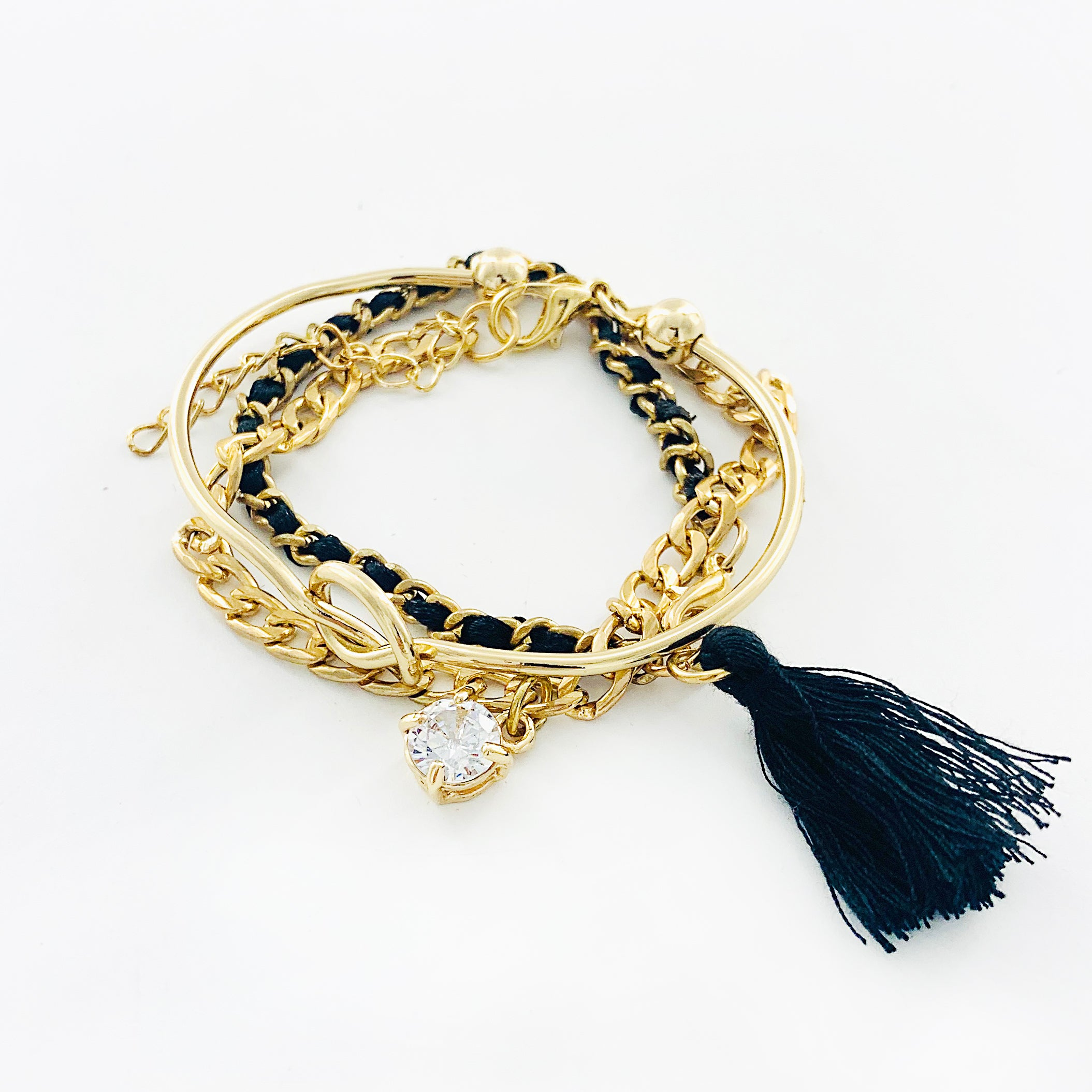 Black and gold multi bracelets with tassel and diamante charm