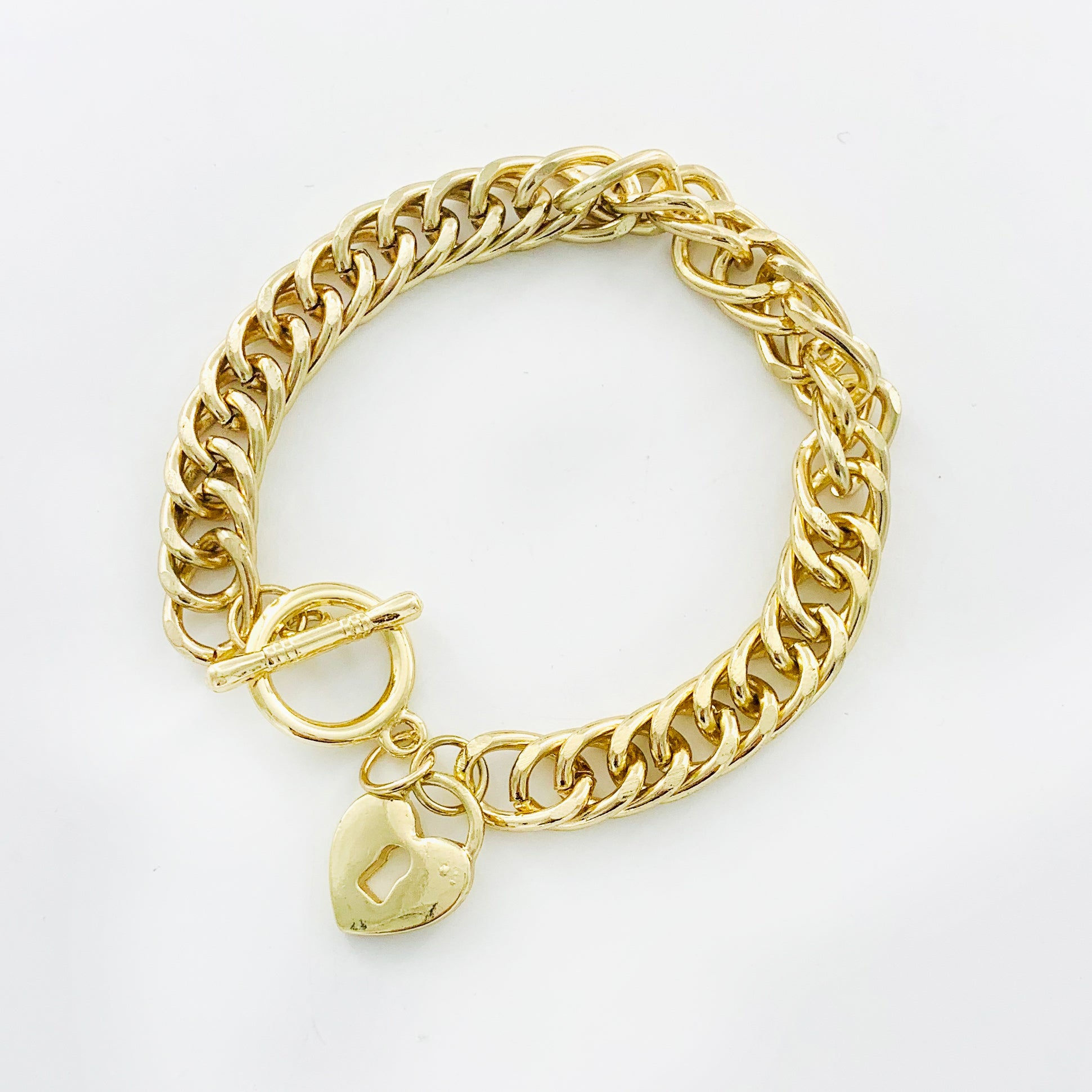 Chunky gold chain with gold heart charm