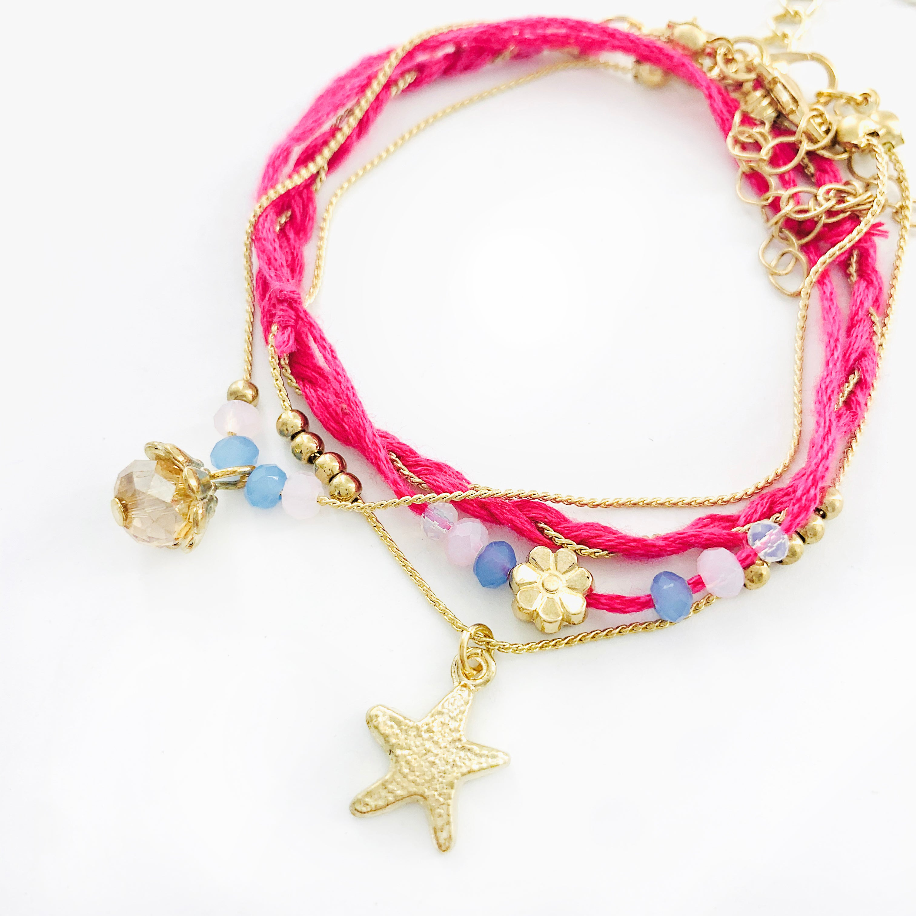Pink string and chain bracelets with star and crystal charm