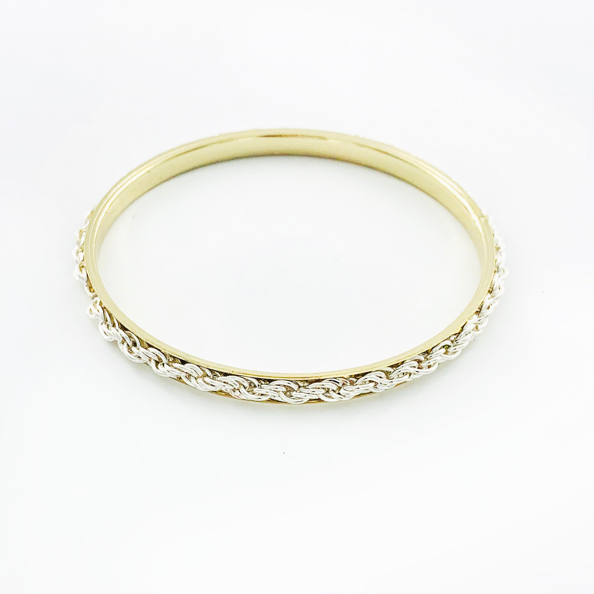 Silver braided chain on thin gold bangle