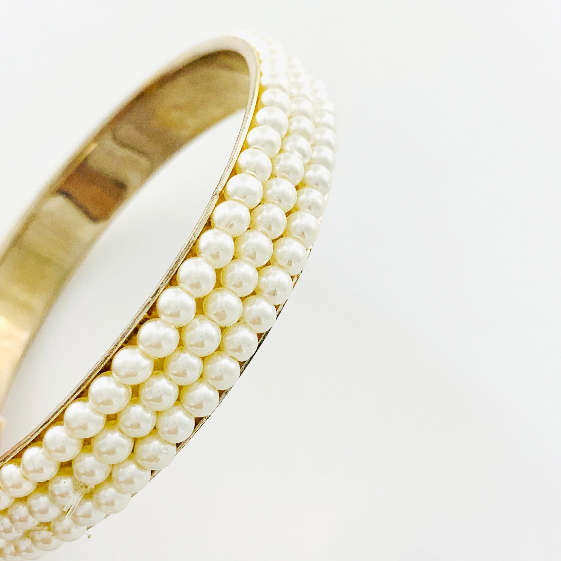 Gold bangle with encircling pearls