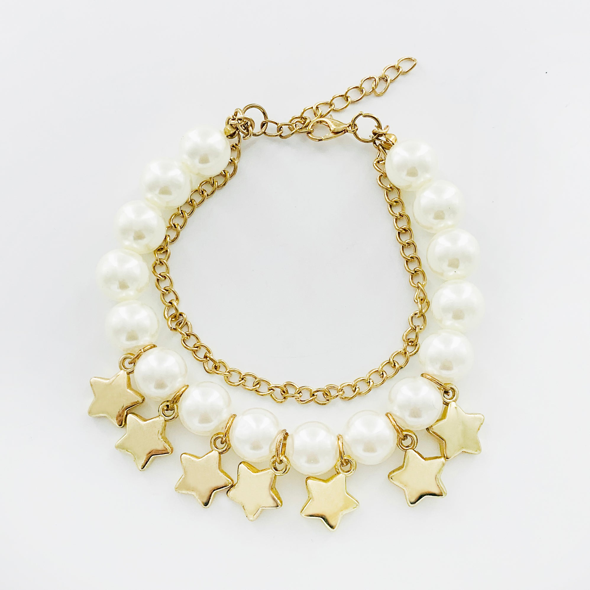 Gold and pearl bracelet with star charms