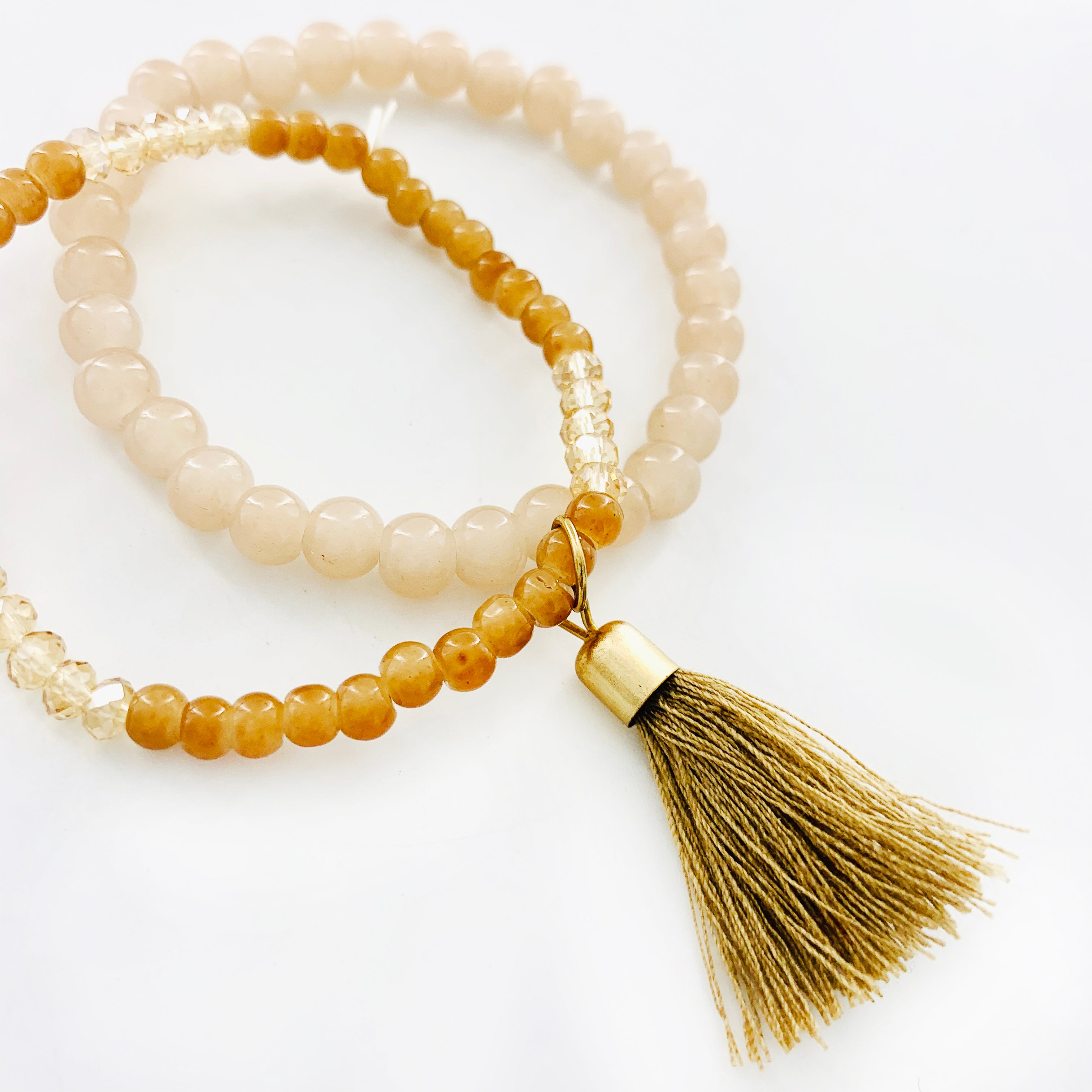 Nude beaded bracelets with tassel charm