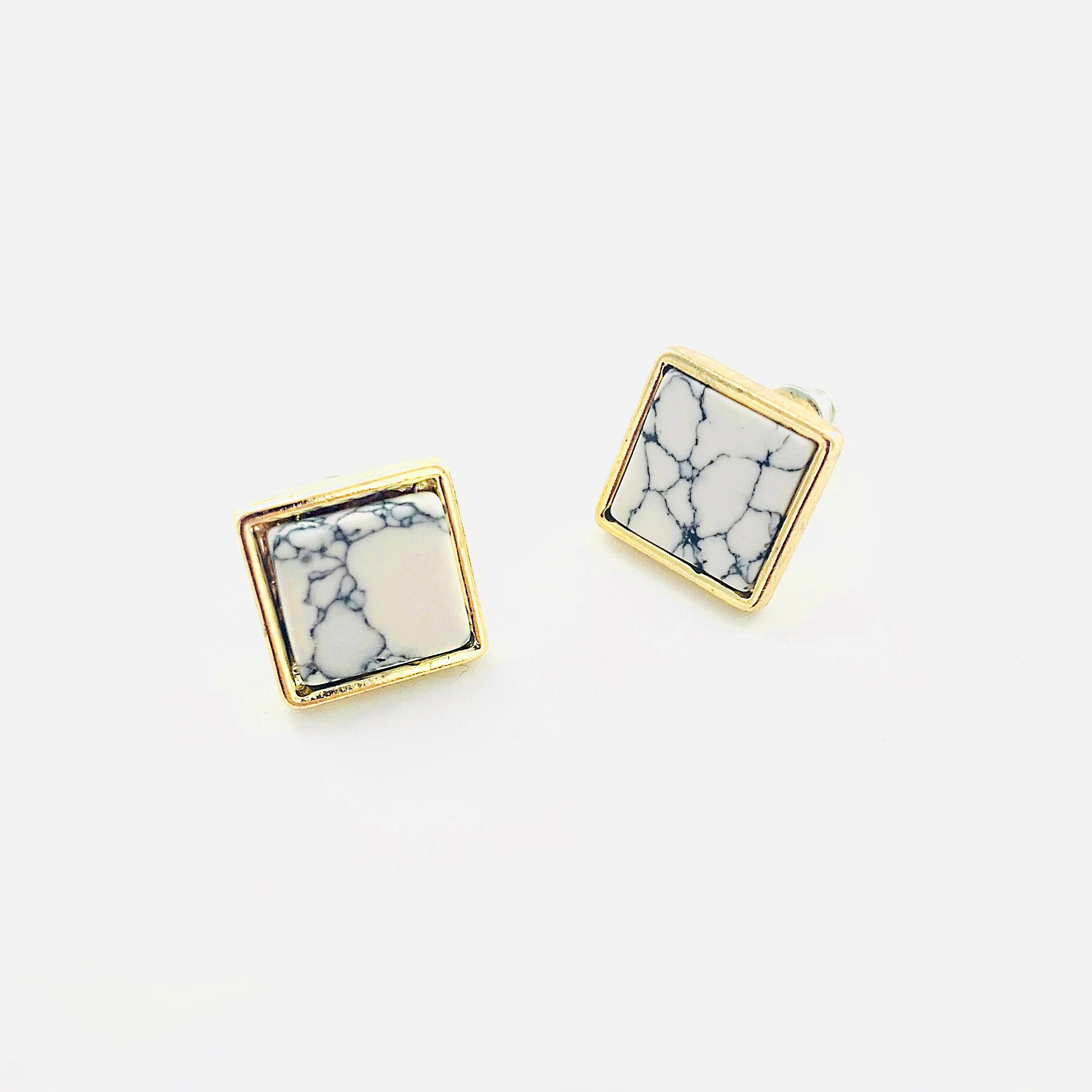 Marble studs with gold edged border