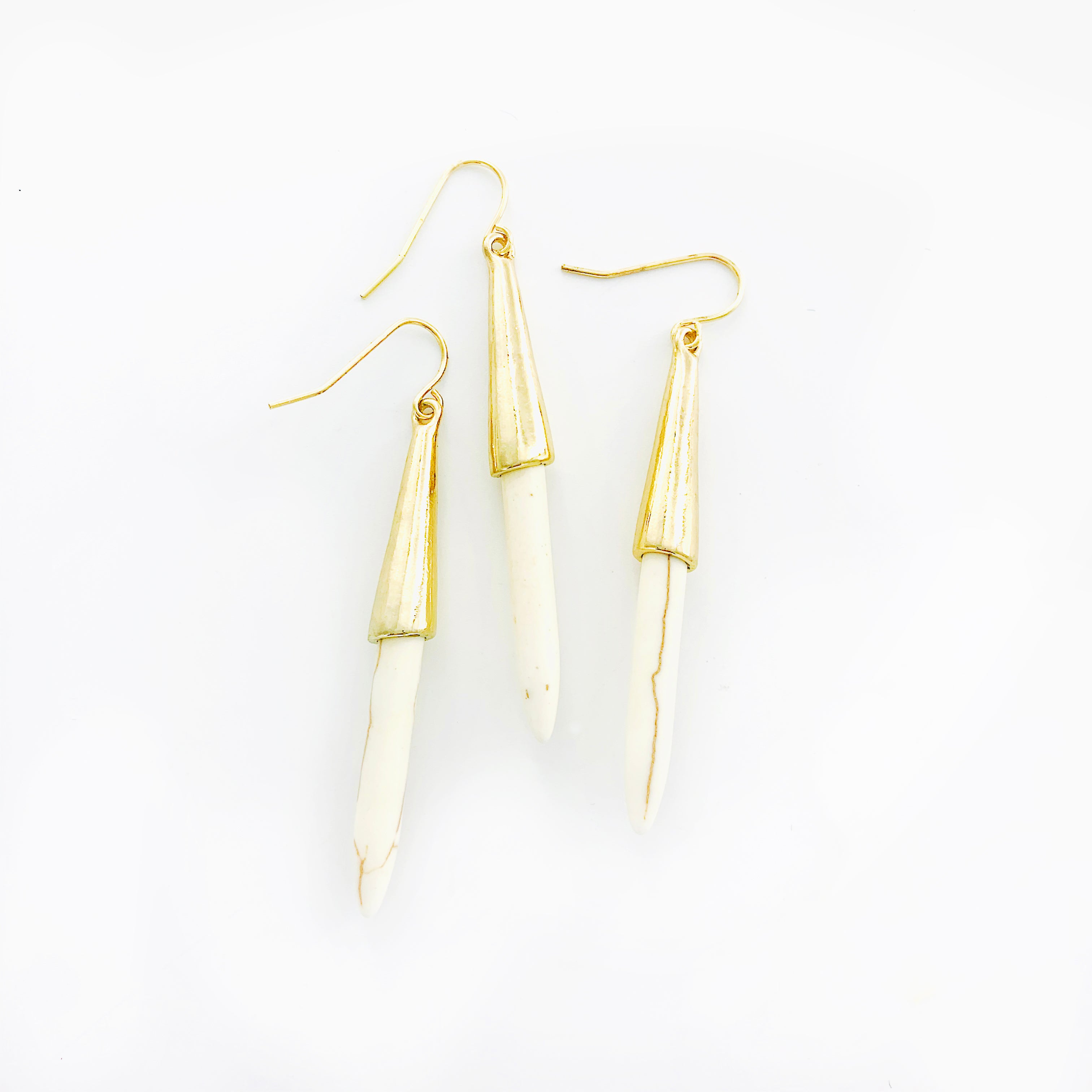 Gold dangling earrings with white marble