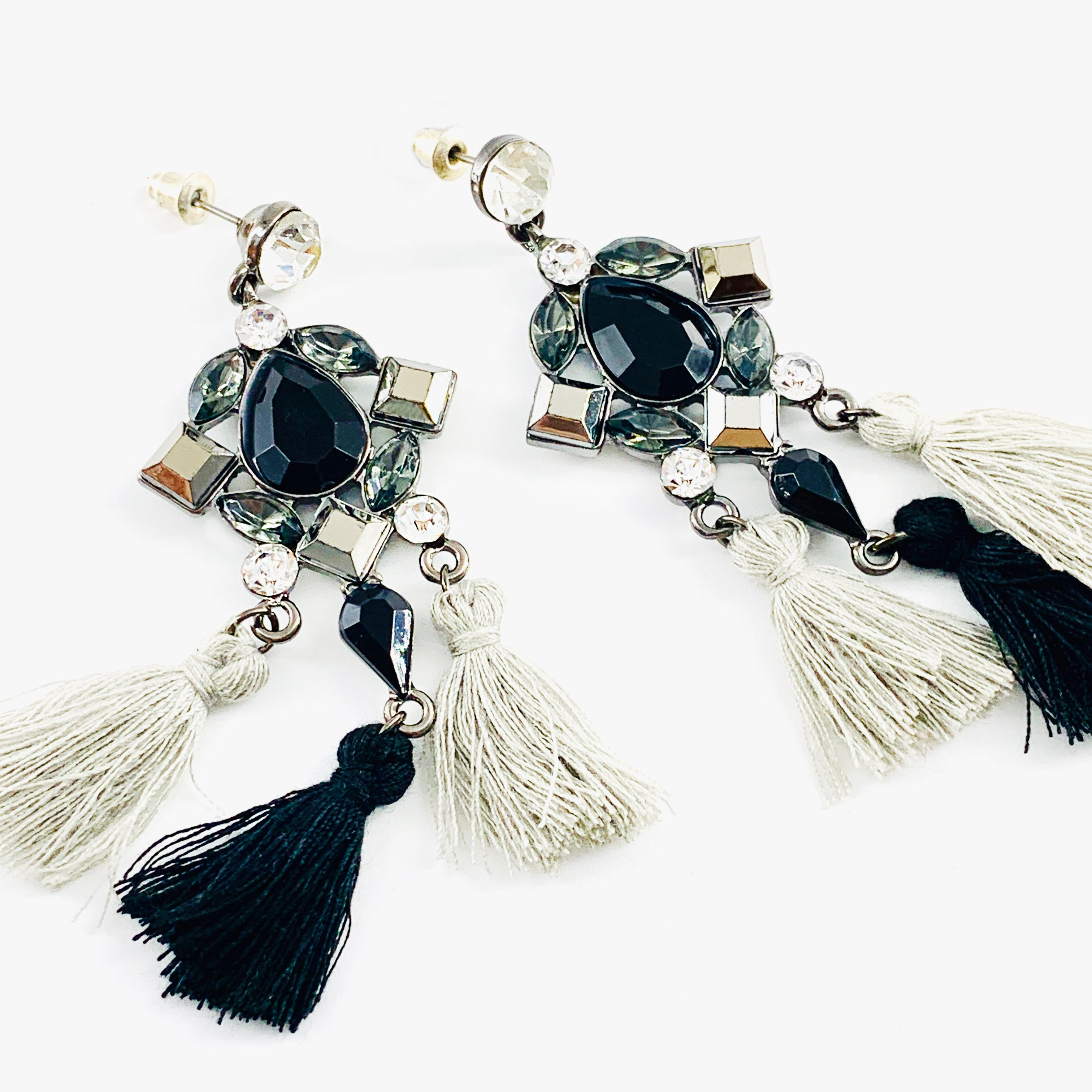 Dangling earrings with facet stones and tassels