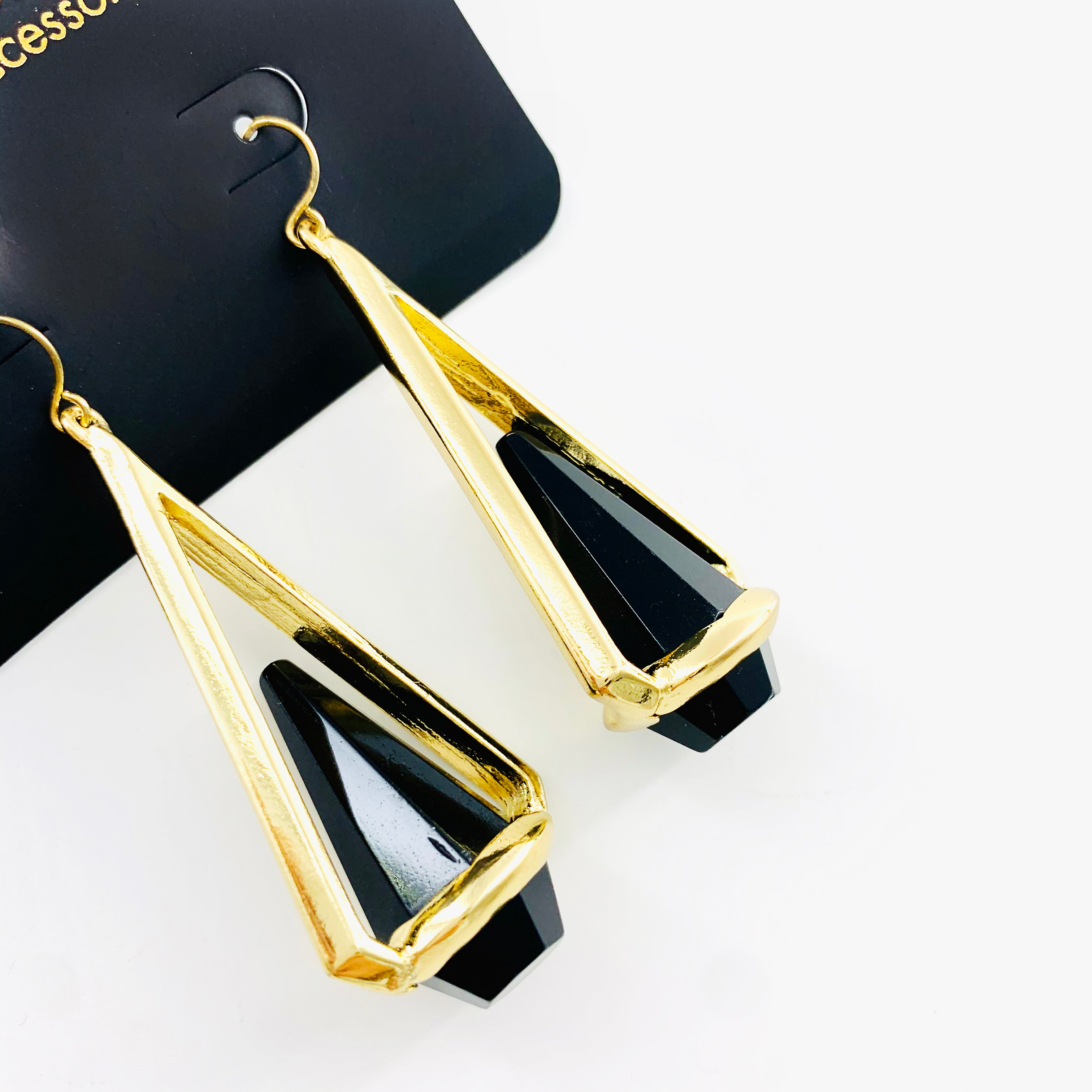 Gold dangling earrings with black facet stones