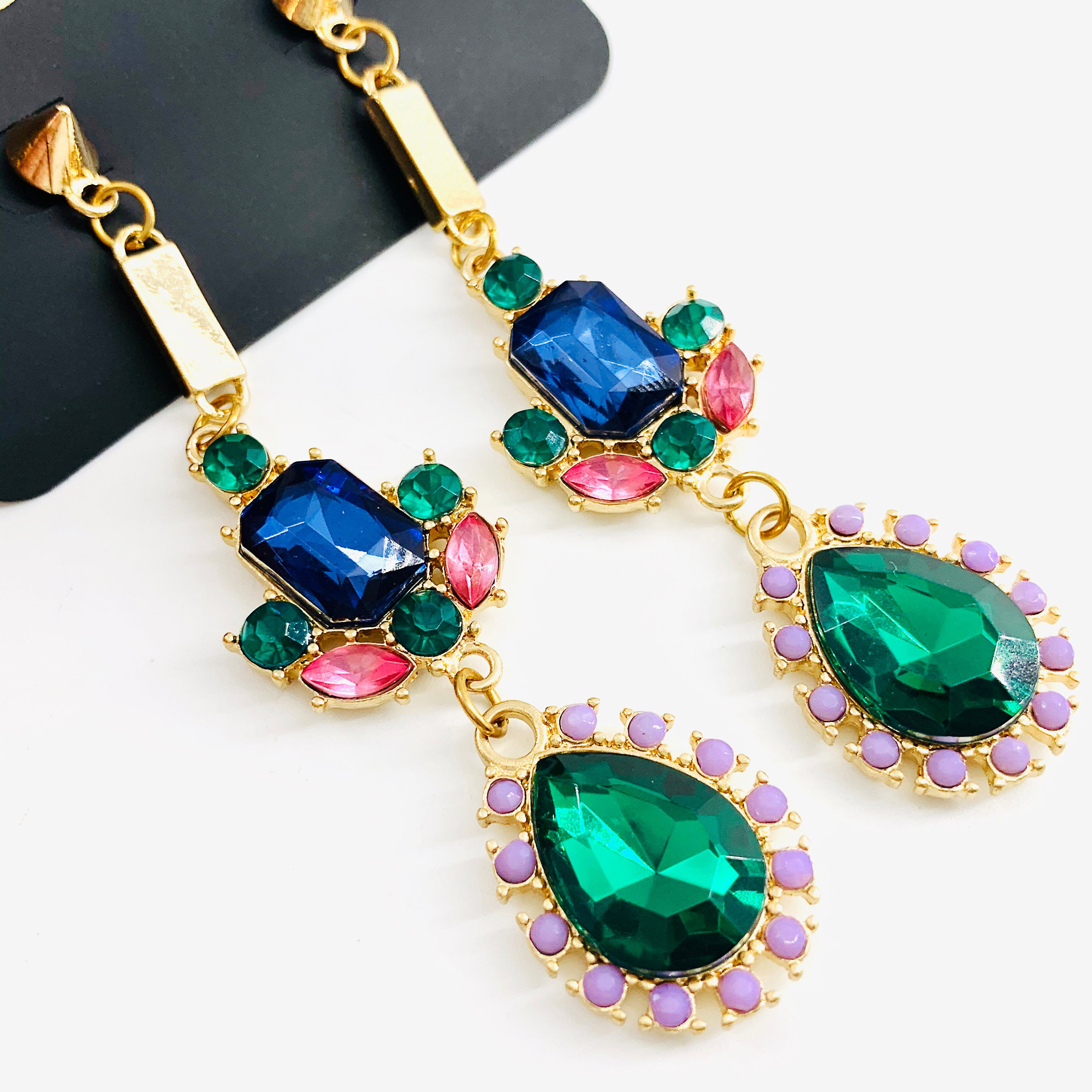 Earrings with emerald, blue, pink and lilac stones