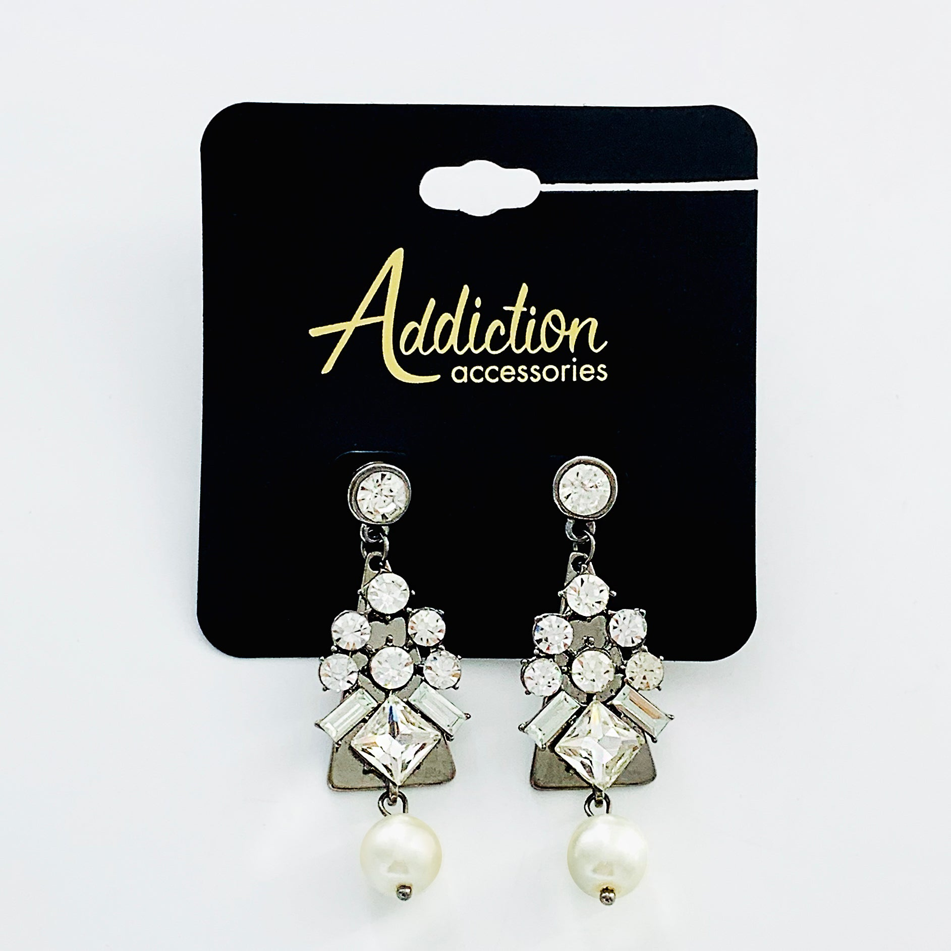 Dangling diamante earrings with pearl
