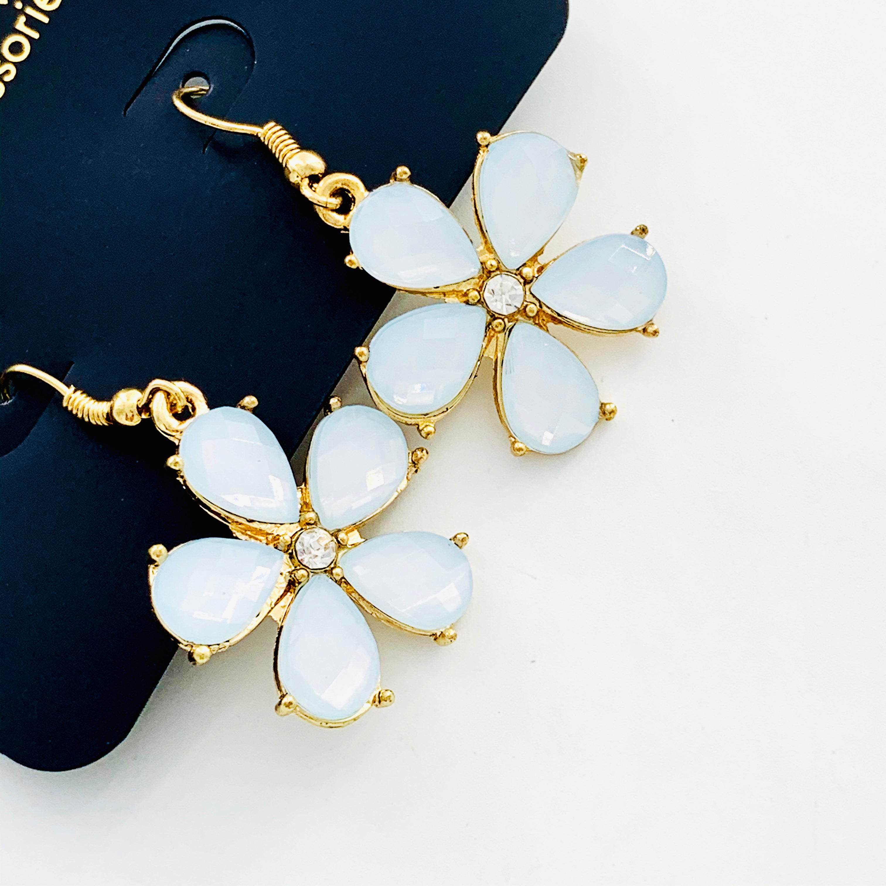 Pale blue flower earrings with teardrop petals