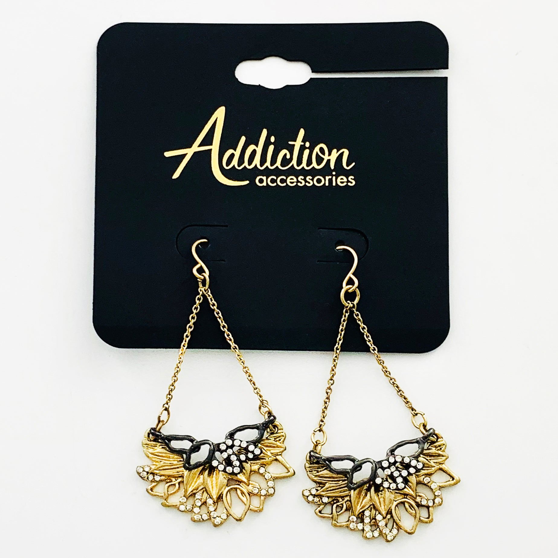 Gold and grey leaf motif dangling earrings