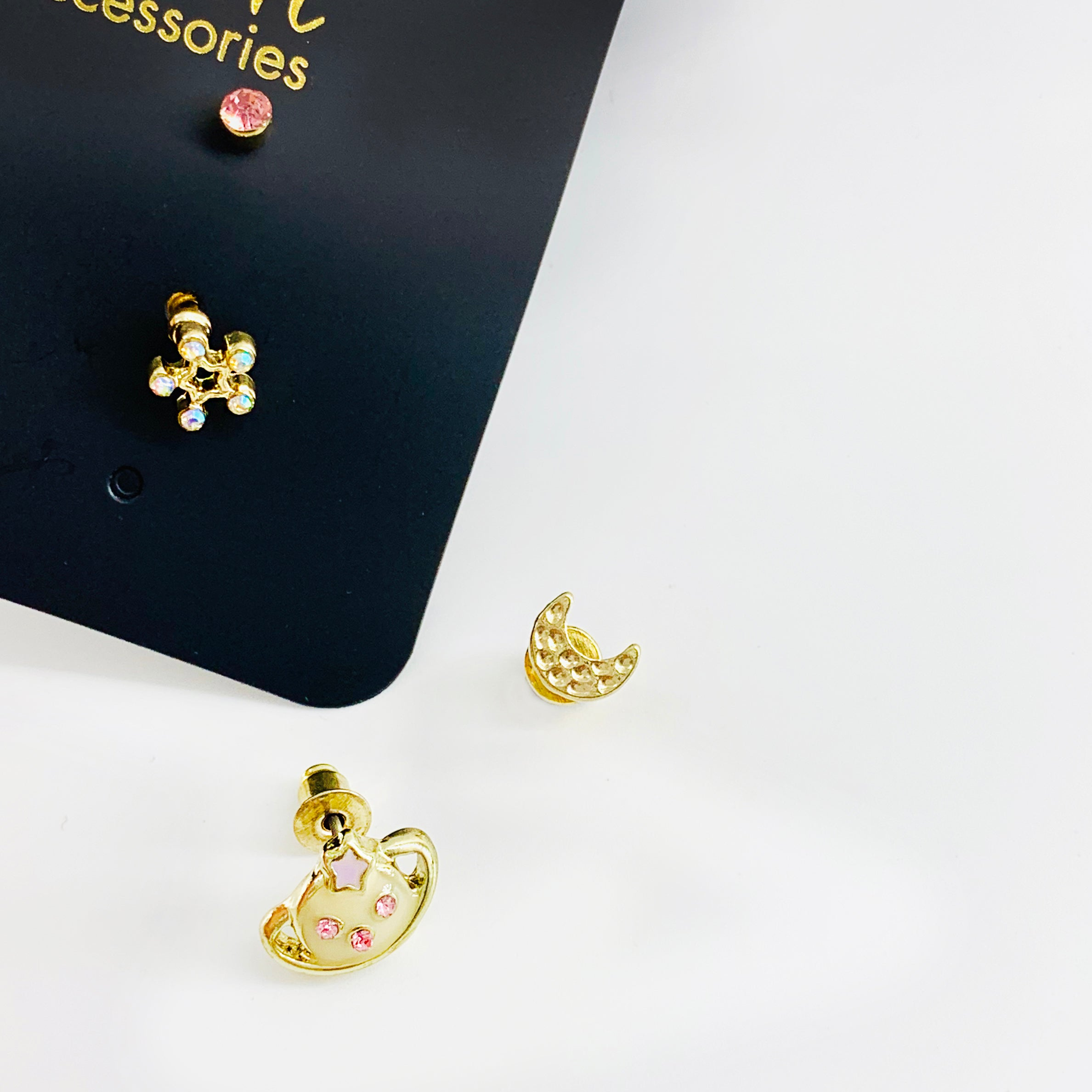 Saturn and flower and crescent ear studs