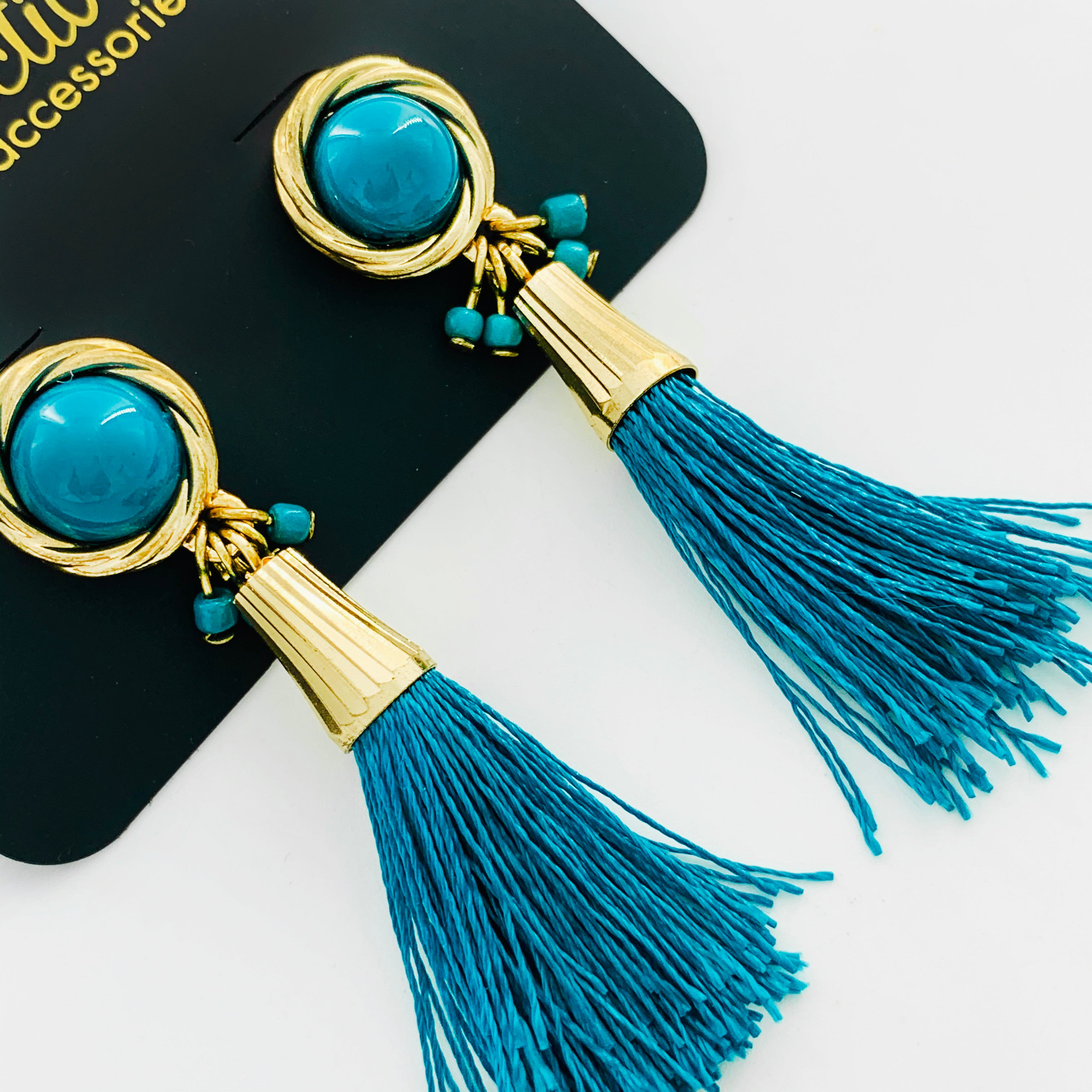 Gold earrings with teal tassels