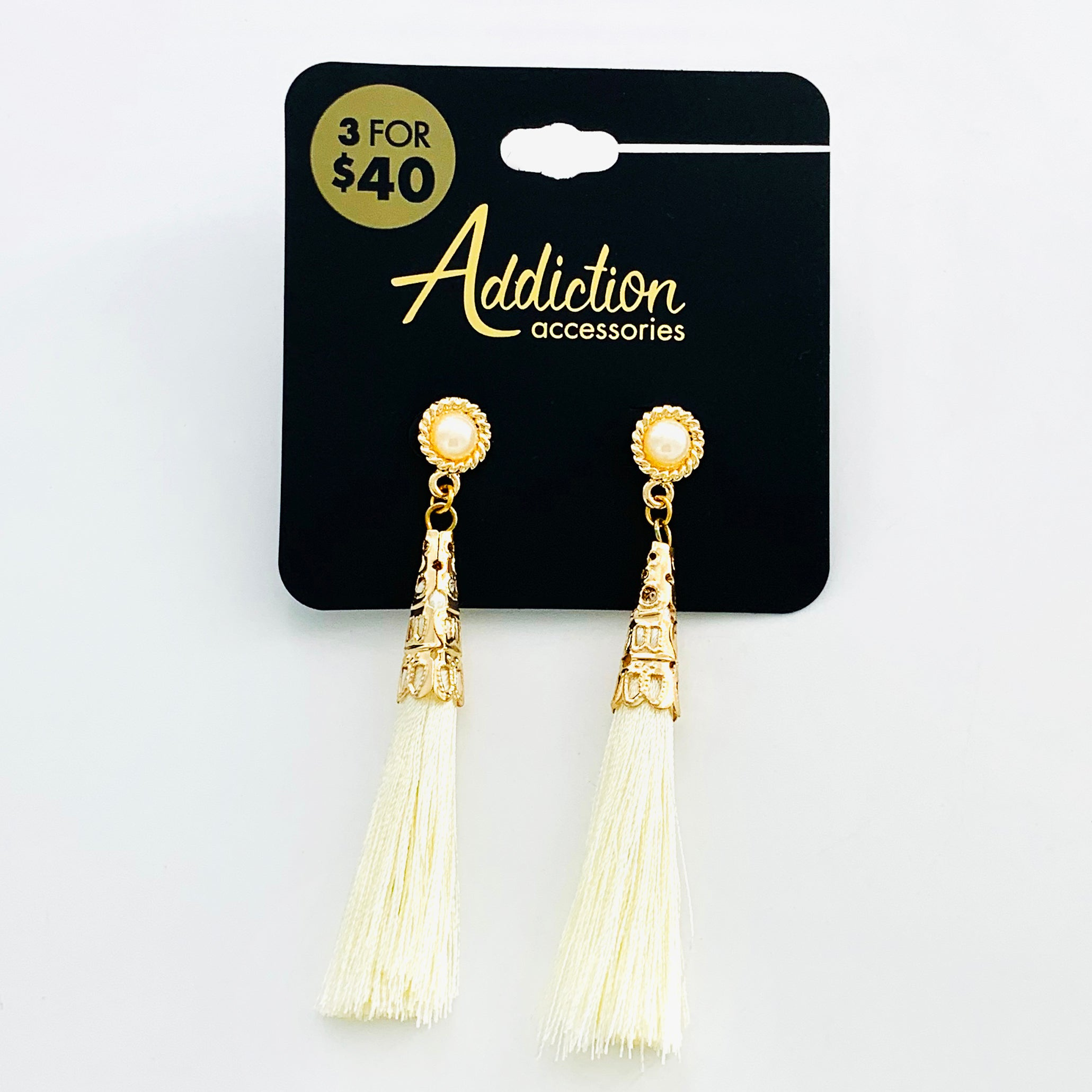 Gold earrings with white tassels