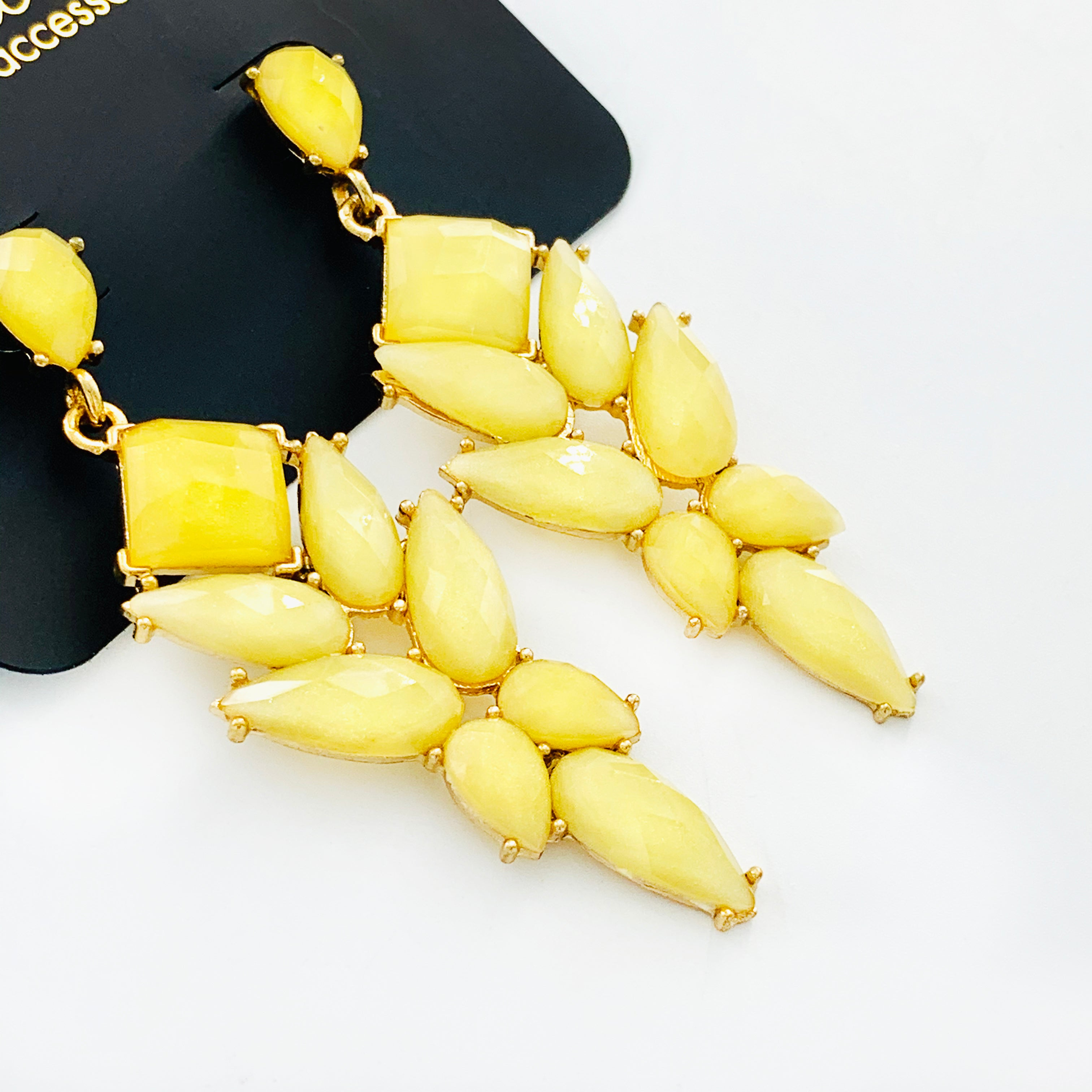 Earrings with faceted yellow teardrops