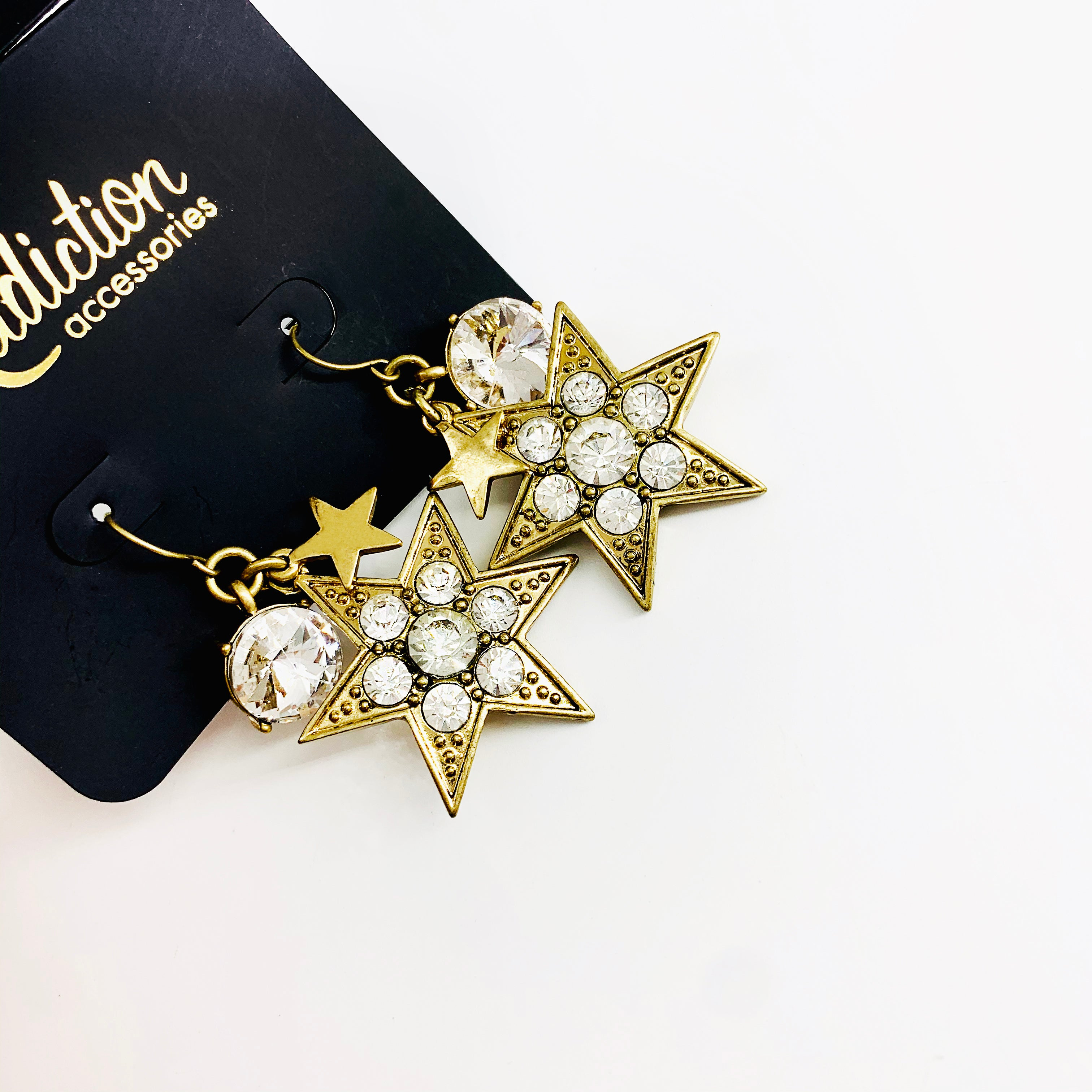 Dark gold star earrings with diamante stones