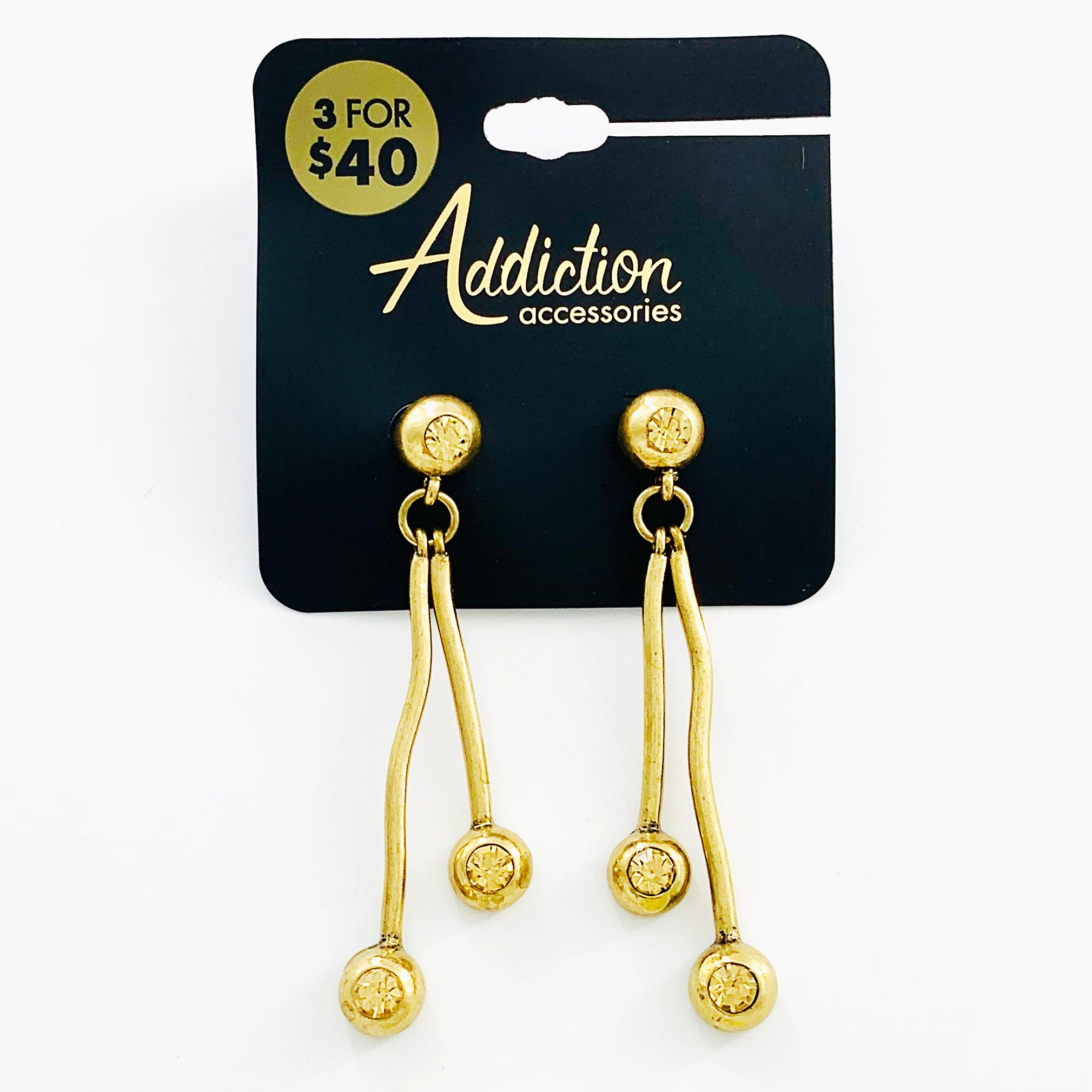 Gold earrings with yellow diamante stones
