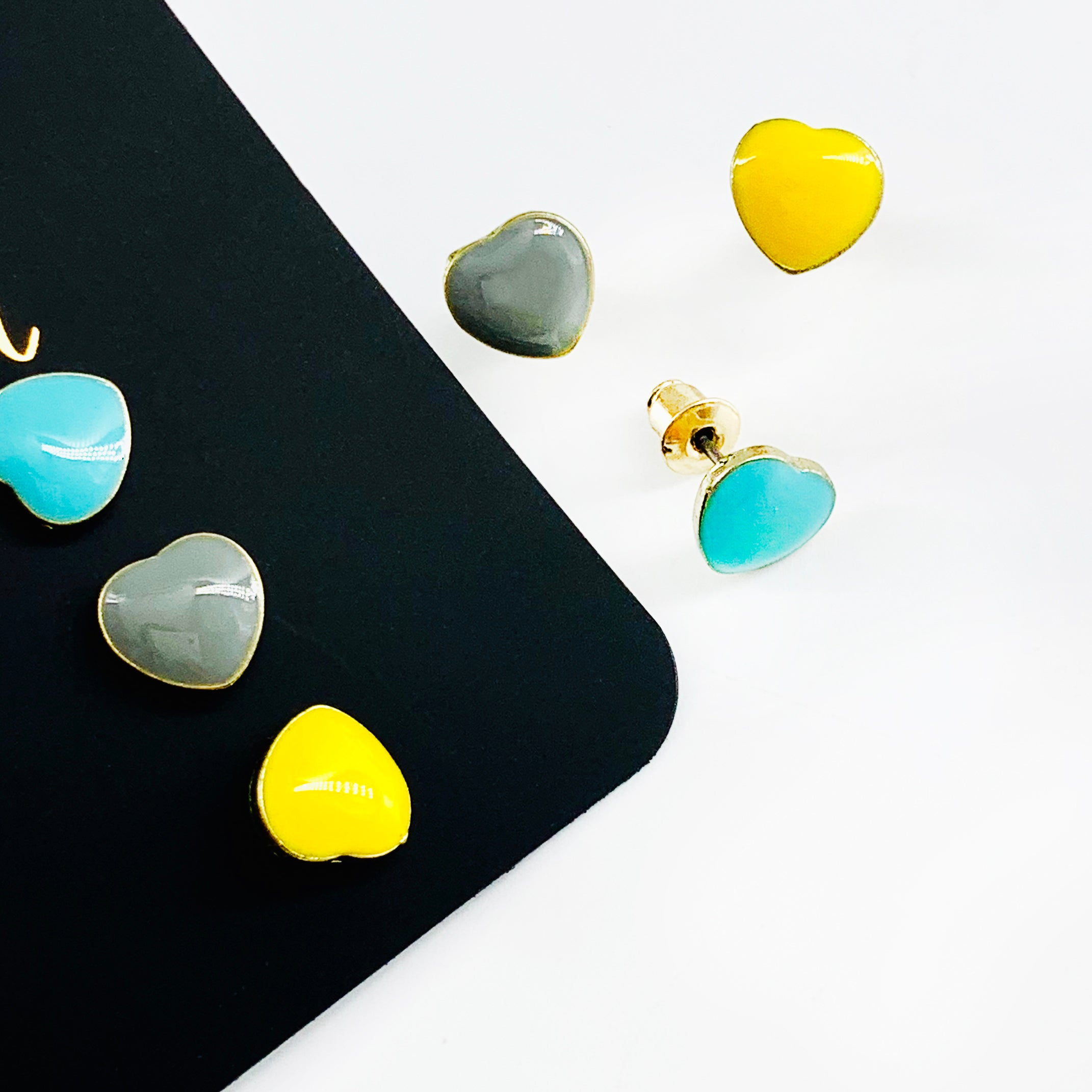 Enamel painted blue, grey and yellow heart earrings