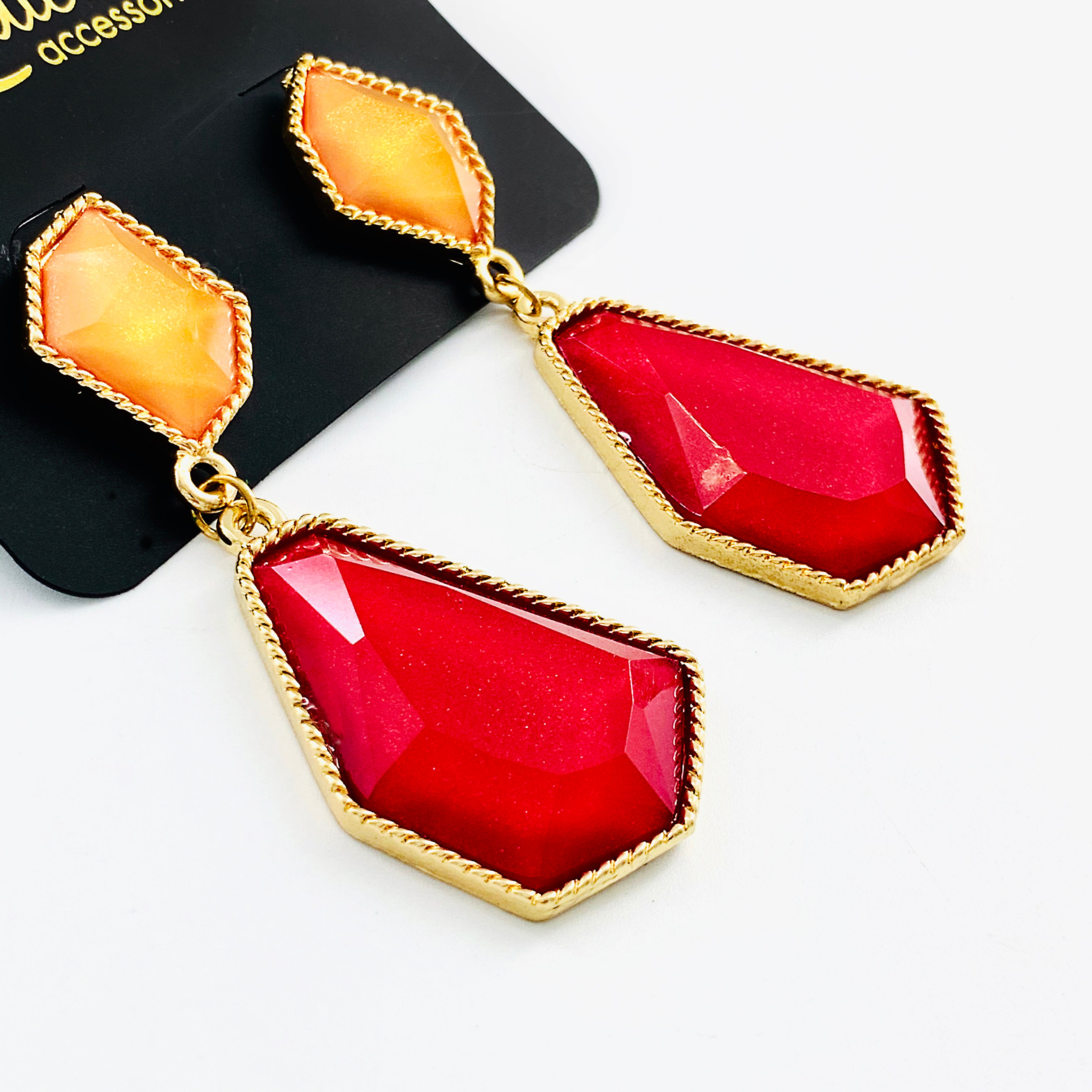 Earrings with orange and red facet stones