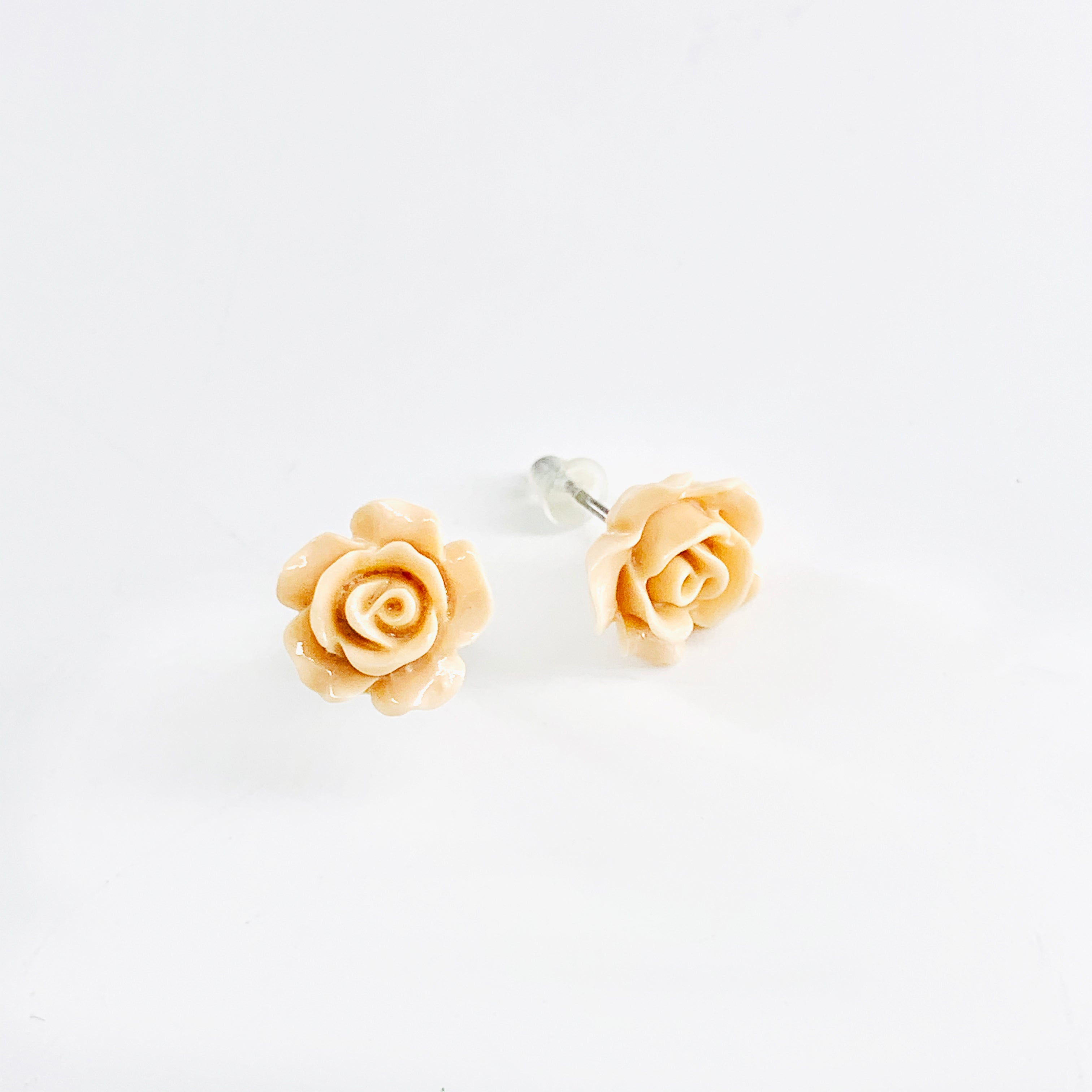 Small rose ear studs in nude colour