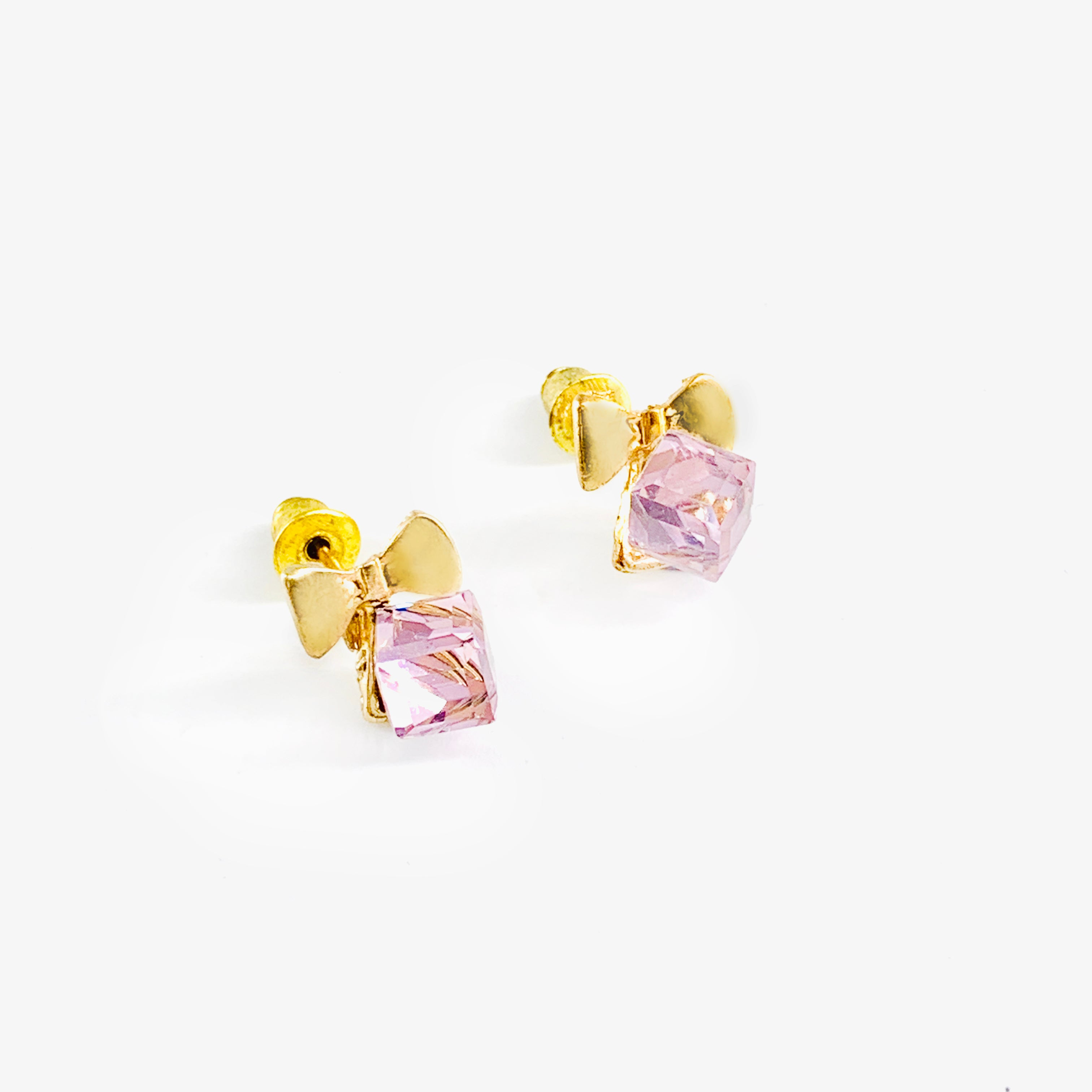 Gold ribbon ear studs with pink cube gem