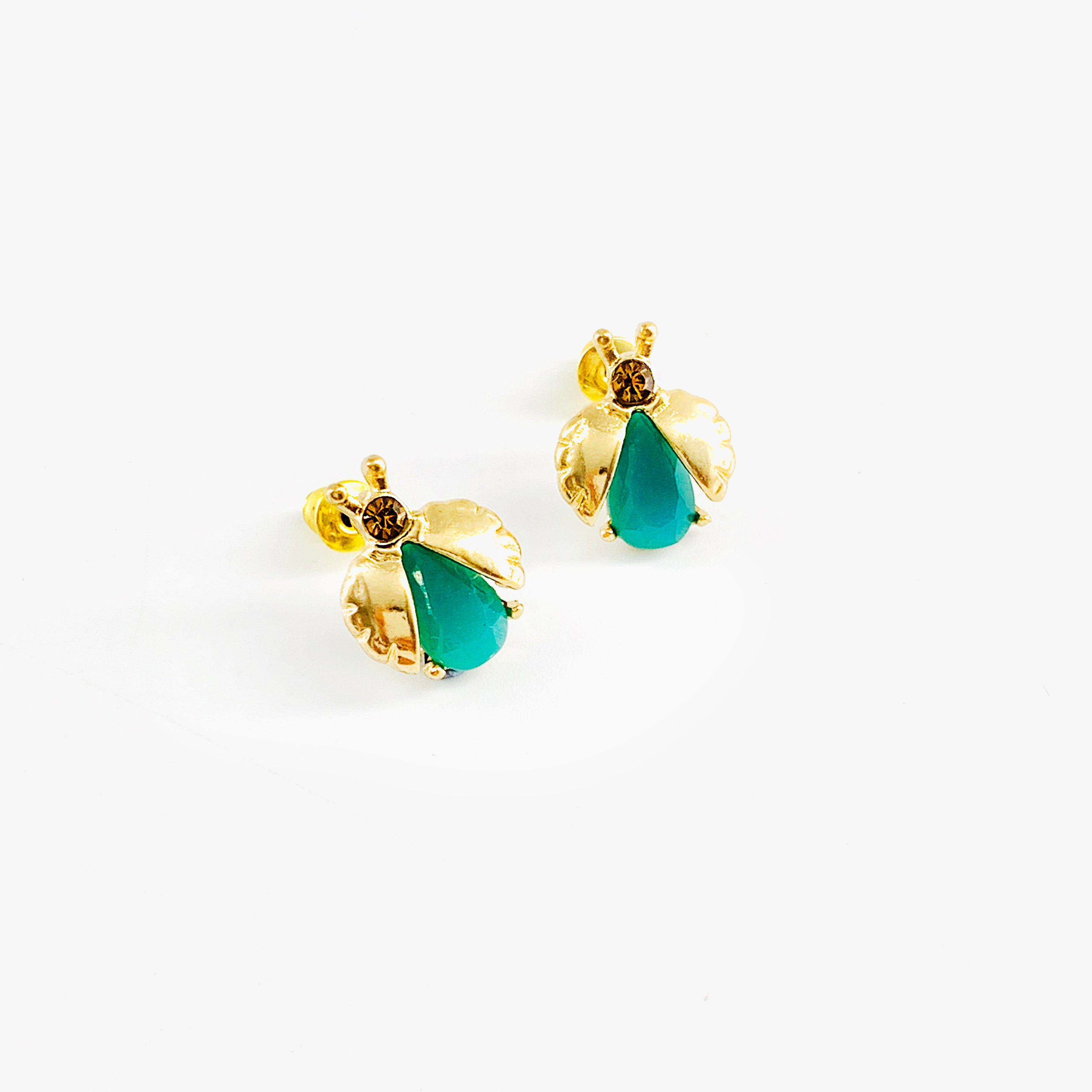 Gold beetle earrings with faceted green gems