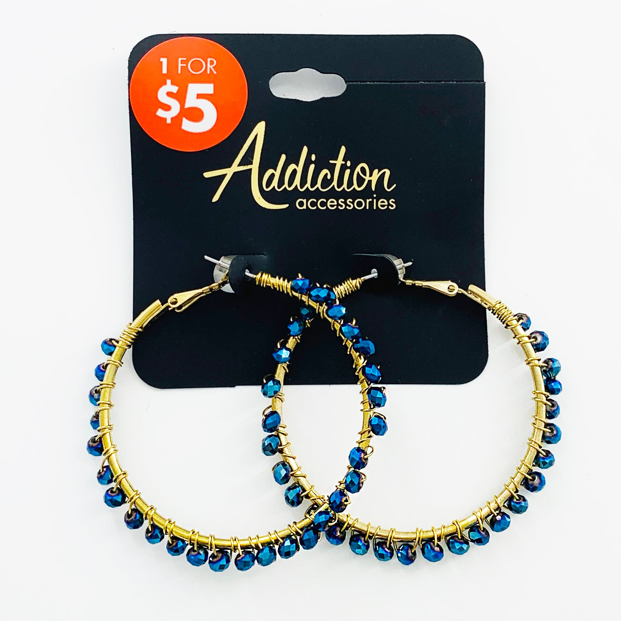 Gold hoops with dark blue facet gems