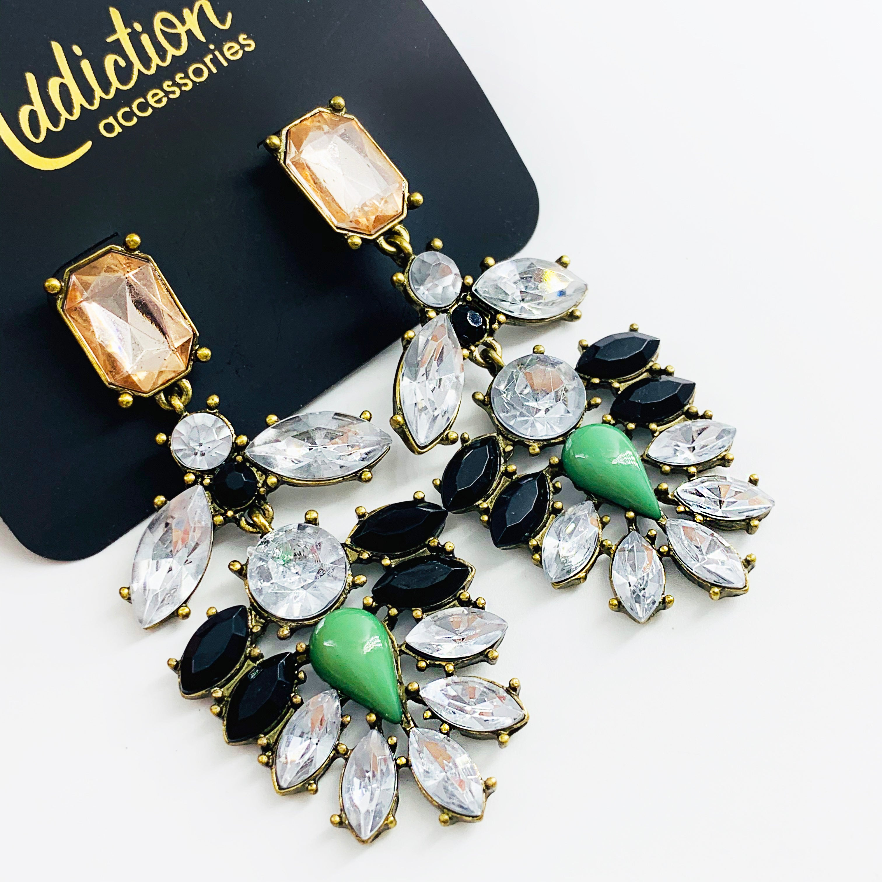 Earrings with faceted black, white and green stones