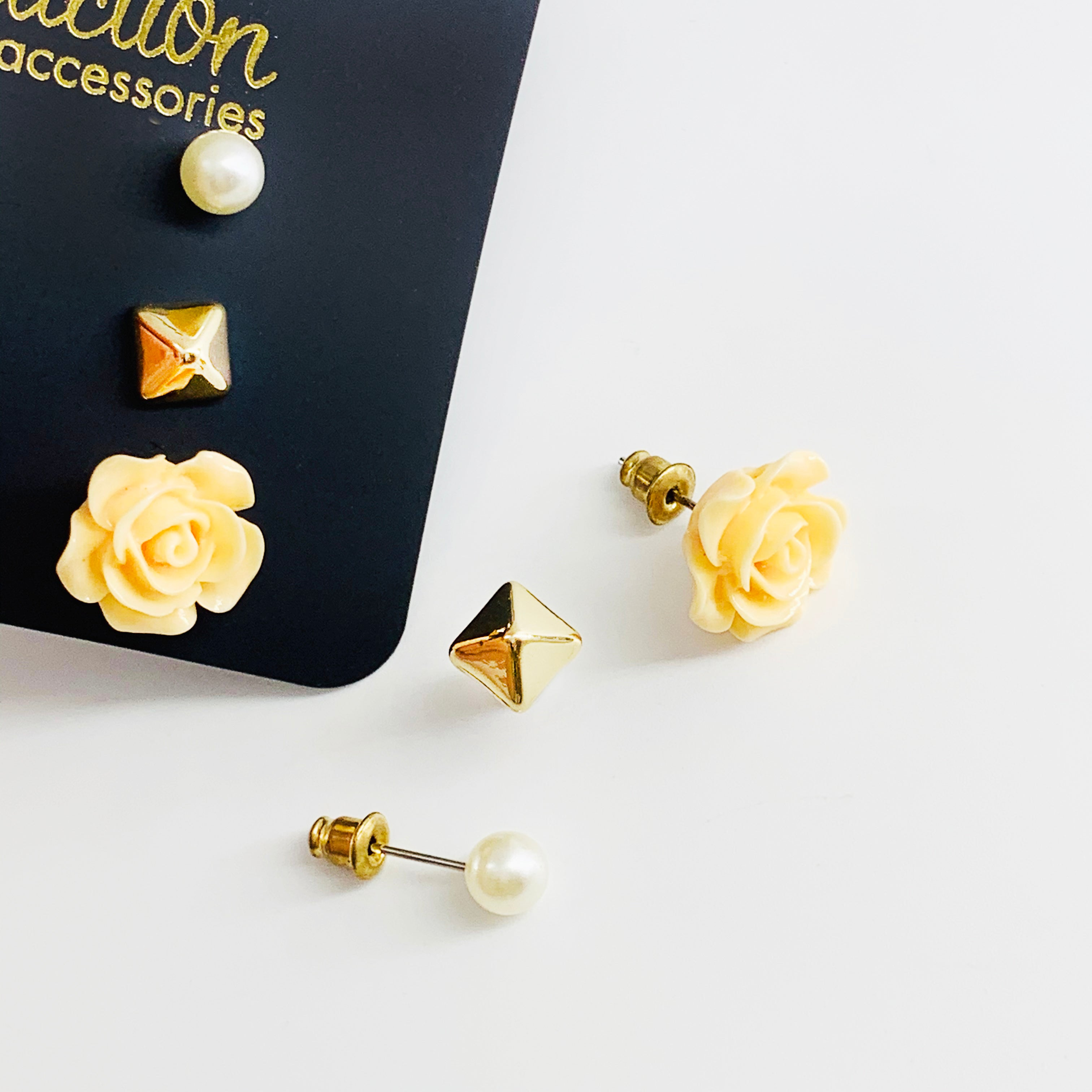 Rose and pyramid and pearl studs