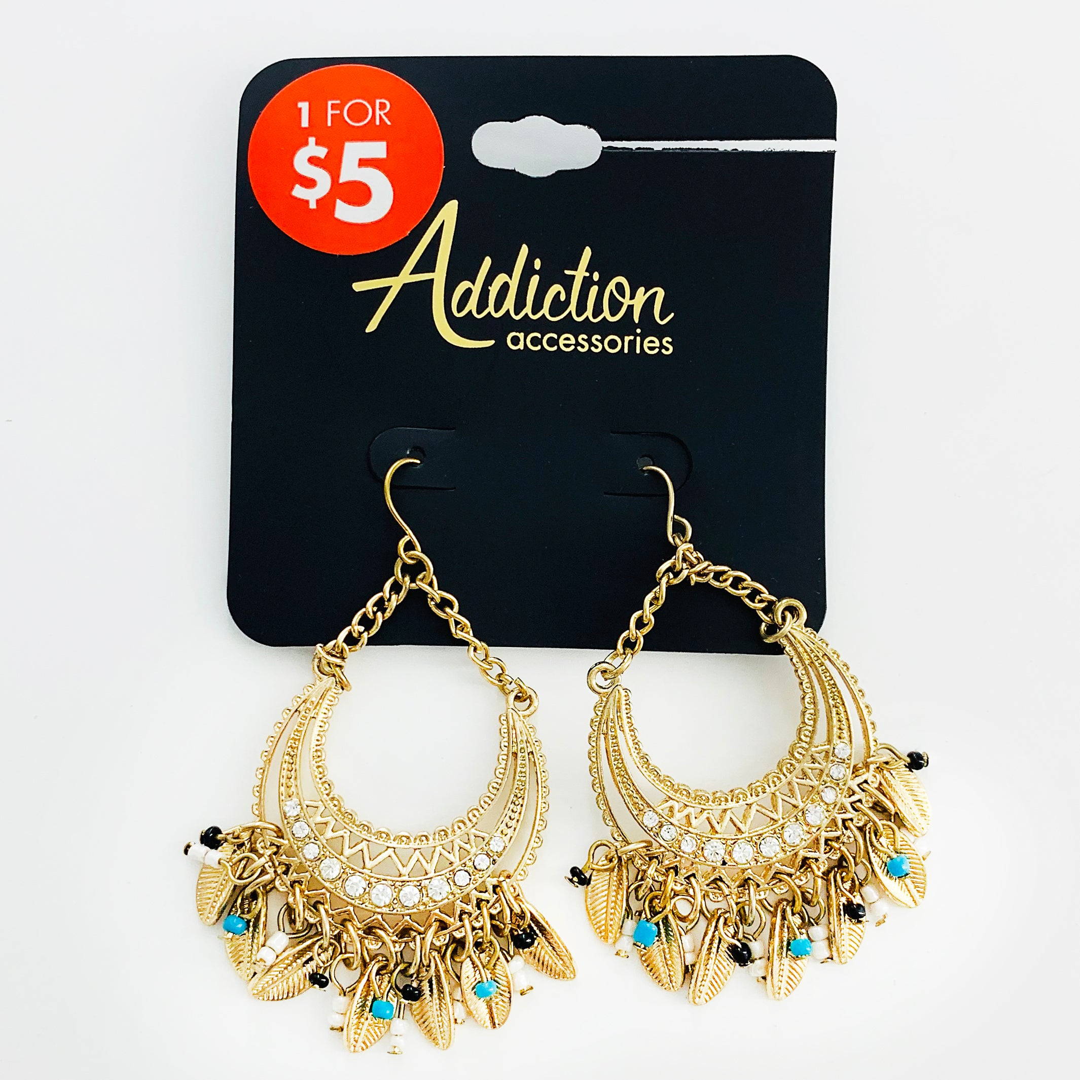 Ethnic-inspired gold earrings with gold leaves