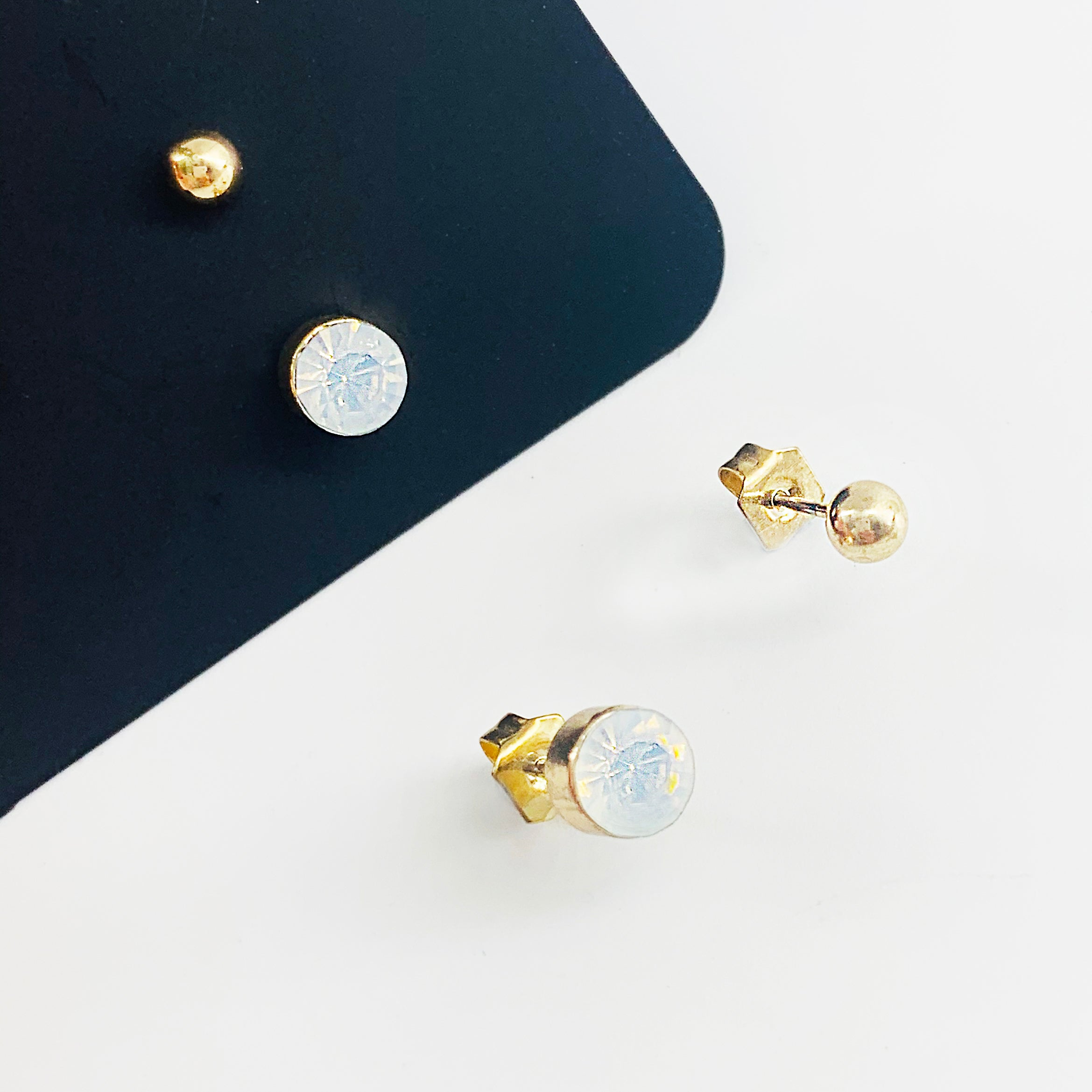 Small white diamante studs with gold ball studs